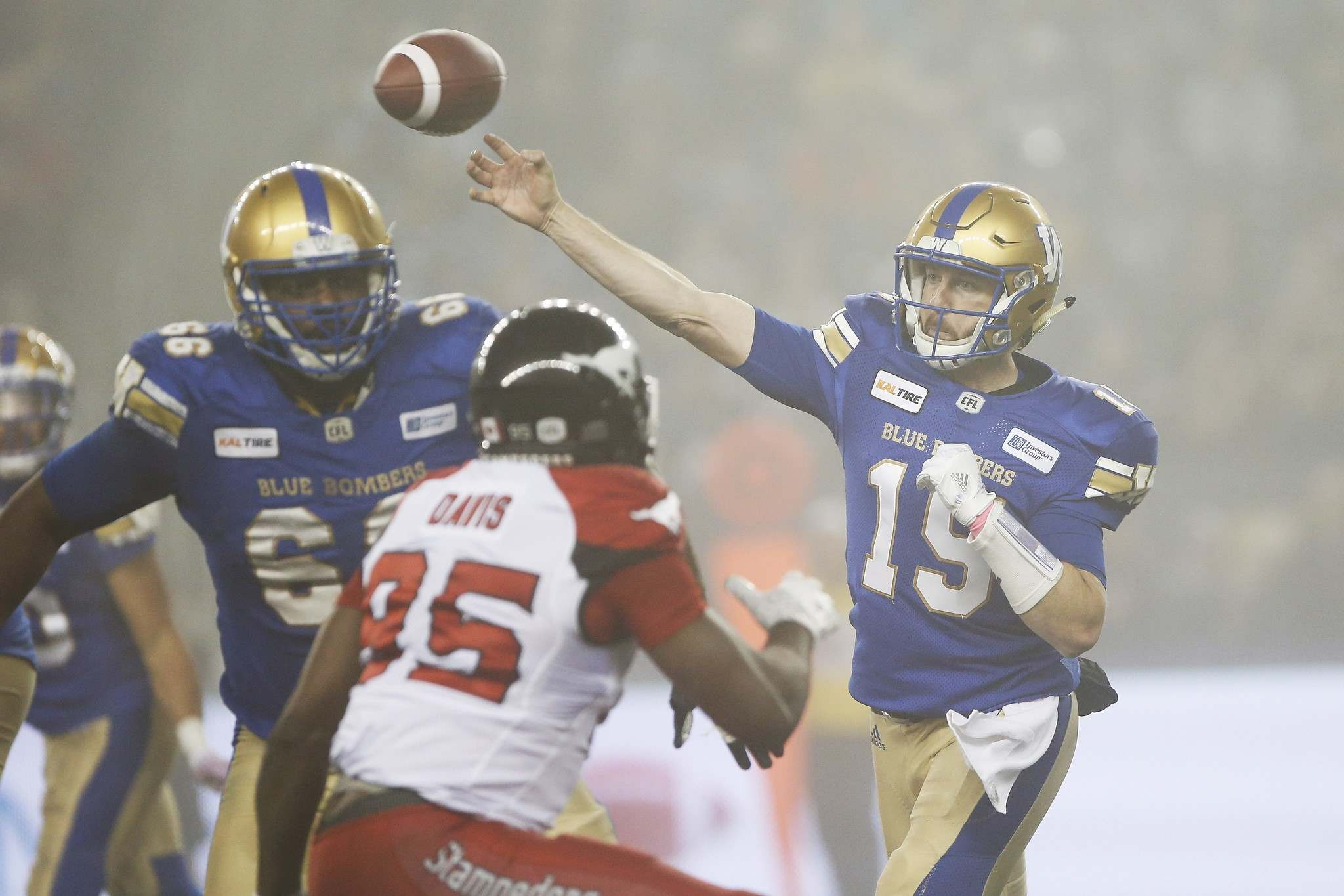Bombers quarterback Matt Nichols throws in the fog against the Stampeders during Friday&rsquo;s game in Winnipeg. JOHN WOODS / THE CANADIAN PRESS</p></p>