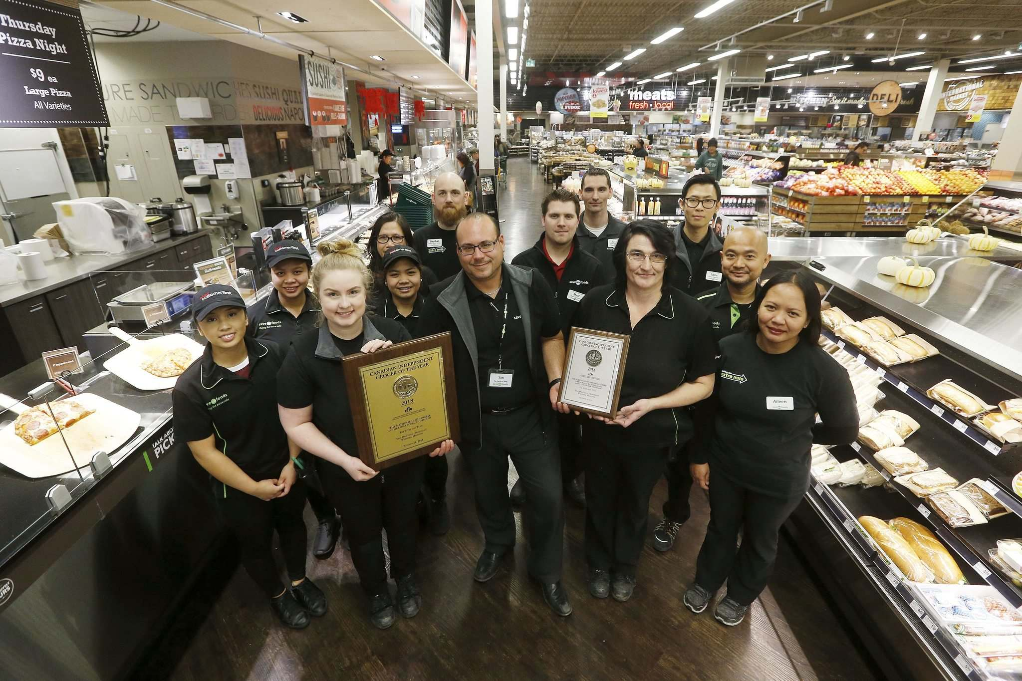 JOHN WOODS / WINNIPEG FREE PRESS</p><p>Save-On-Foods store manager Tim Styba (centre) credits a 'power team' with the Northgate location's success — the location has been named the best large-space grocer in the country by the Canadian Federation of Independent Grocers.</p>