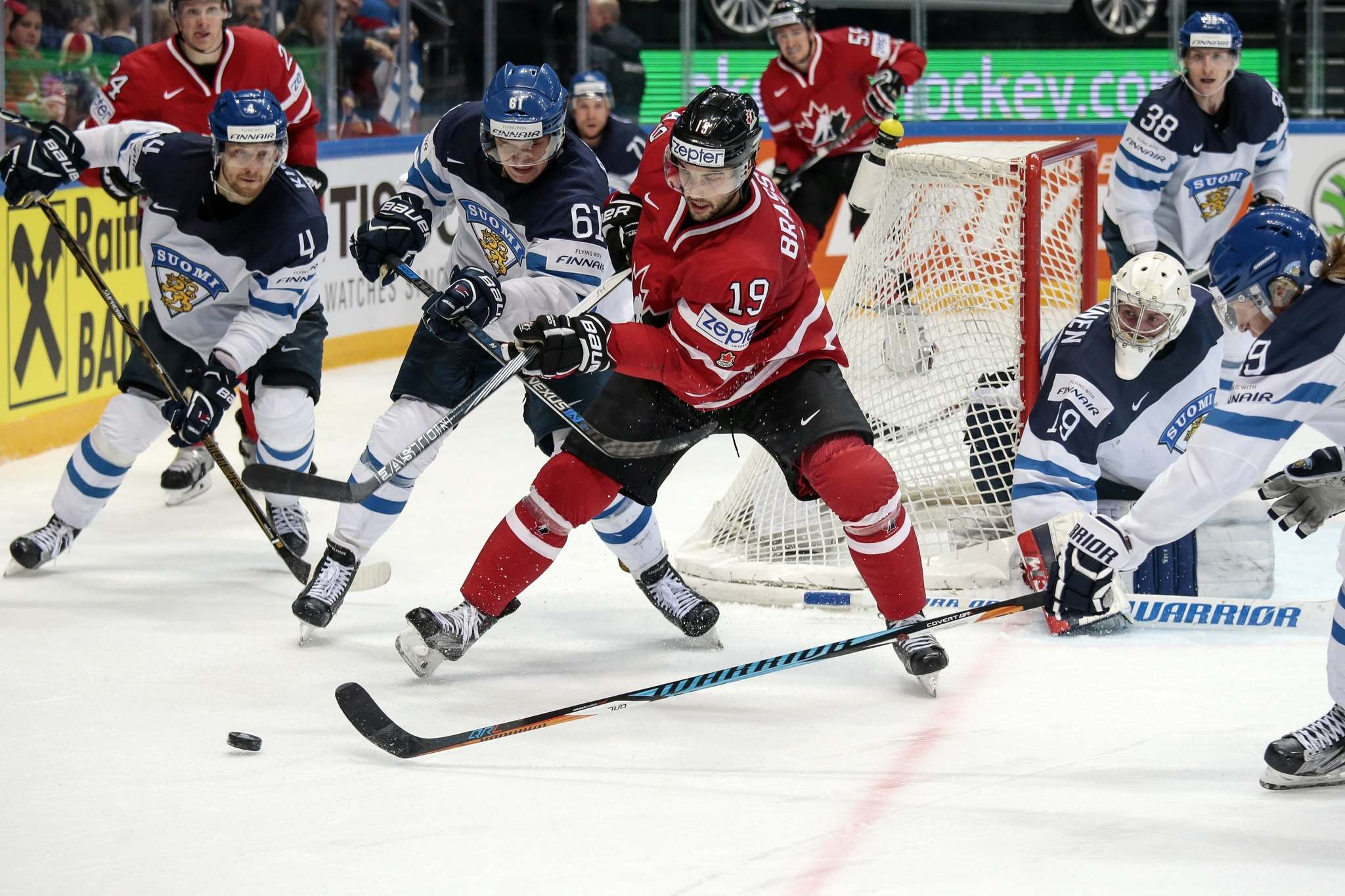 Finland's Aleksander Barkov (second from left) and Patrik Laine (right) battle for the puck with during the Ice Hockey World Championships final in 2016. The two have openly traded barbs since the NHL Global Series was announced in January, yet the admiration comes through loud and clear. (Pavel Golovkin / The Associated Press files)</p>