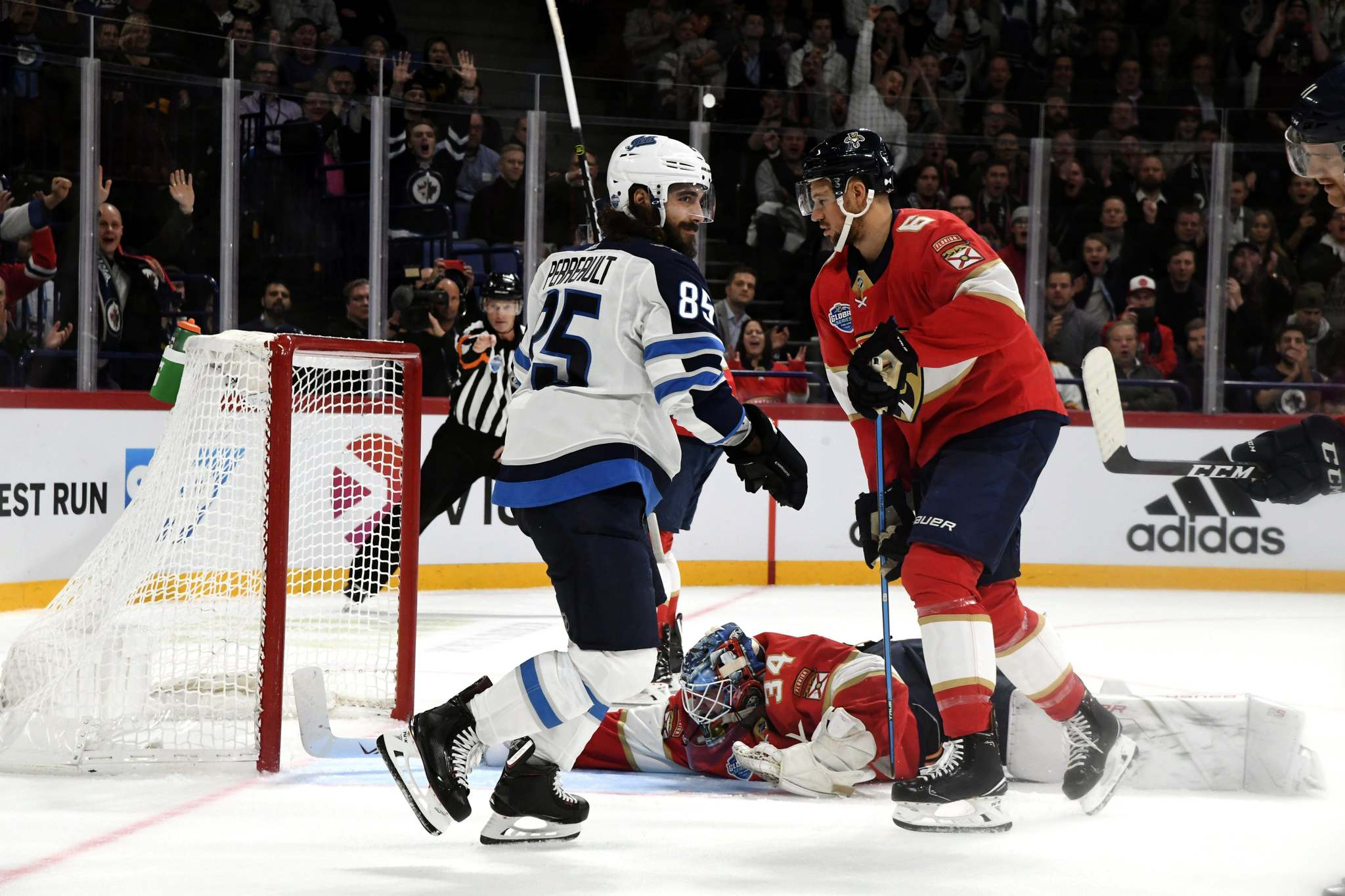 Heikki Saukkomaa / Lehtikuva / The Associated Press</p><p>Jets forward Mathieu Perreault (above, left) celebrates after scoring during Game 1 of the NHL Global Series.</p>