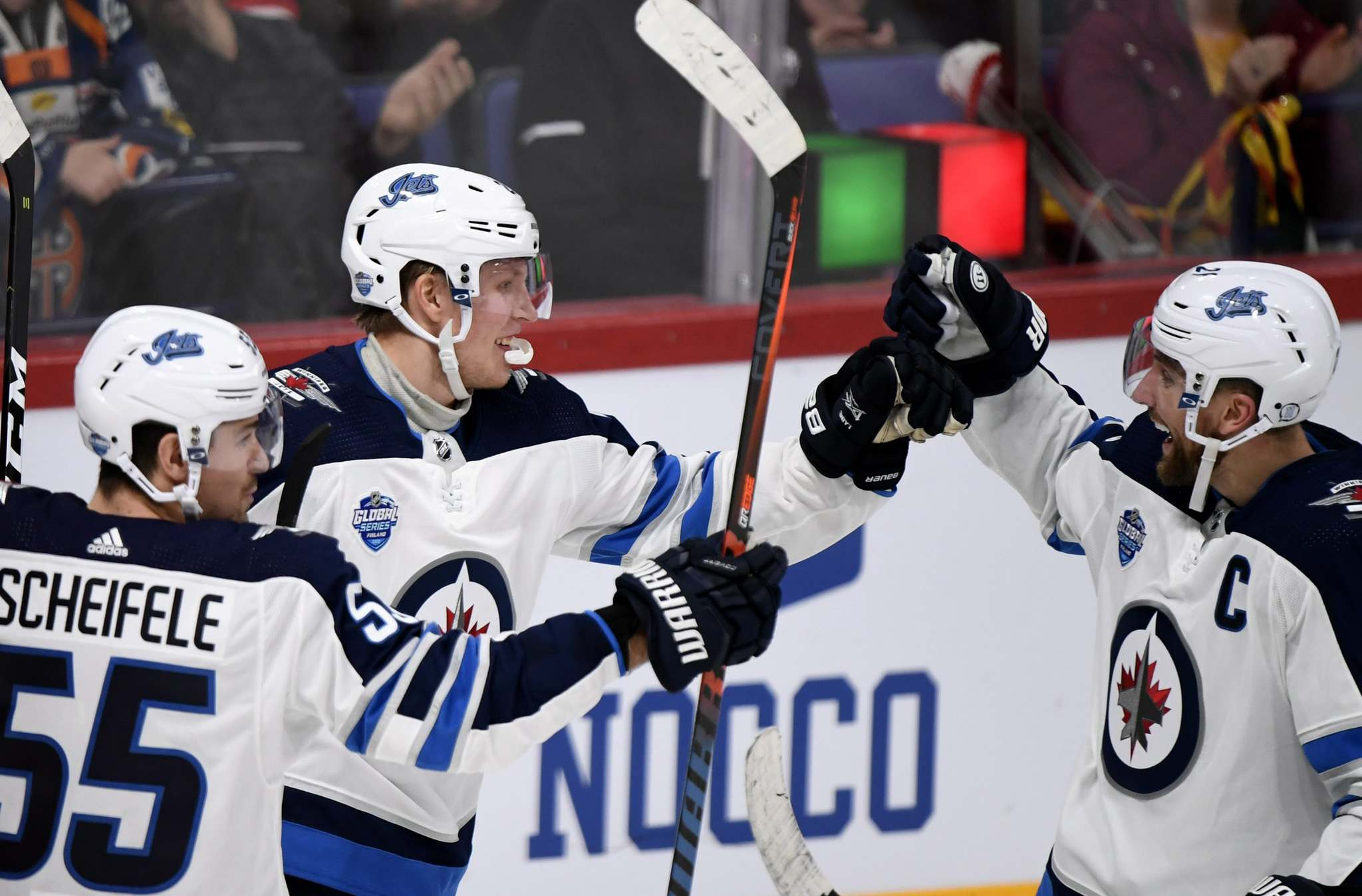 Patrik Laine celebrates a goal with Mark Scheifele (55) and Blake Wheeler in Helsinki, Finland last week. (Martti Kainulainen / Lehtikuva files)</p>