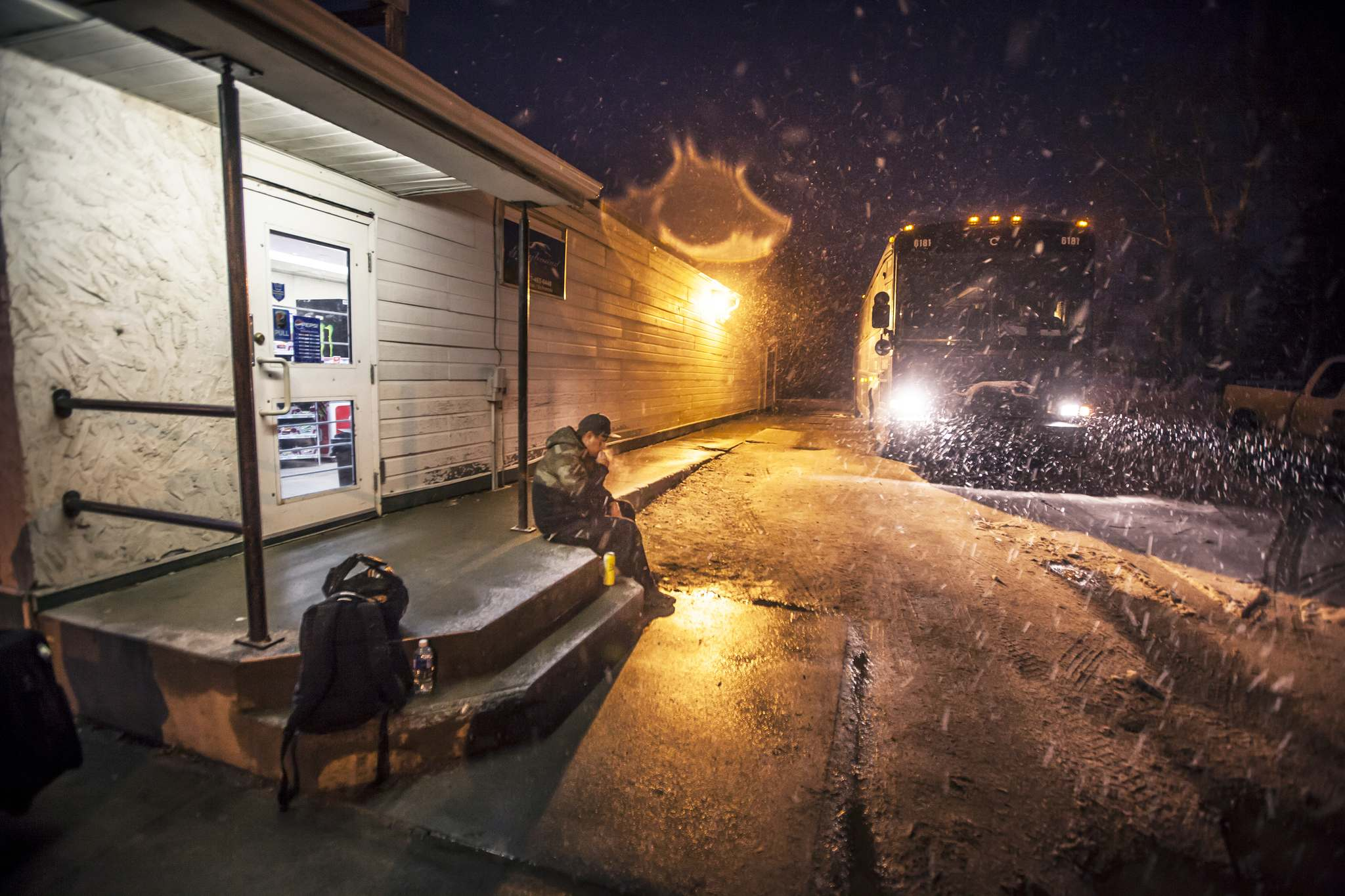 Justin Spence, who is headed to Thompson and Nelson House via The Pas, waits outside the Creighton Saskatchewan convenience store that acts as Flin Flon's Greyhound depot.</p>