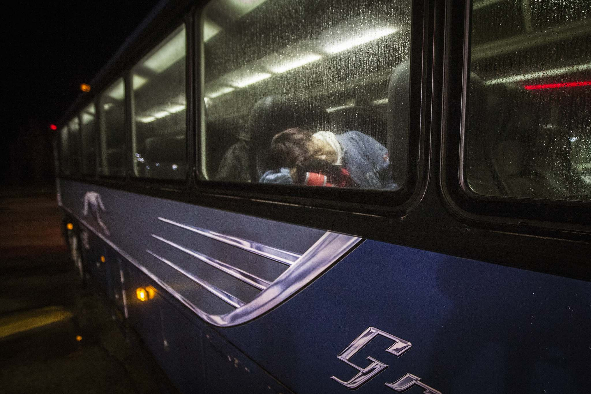A passenger sleeps through a ten-minute stop in Gladstone on Highway 16.</p>