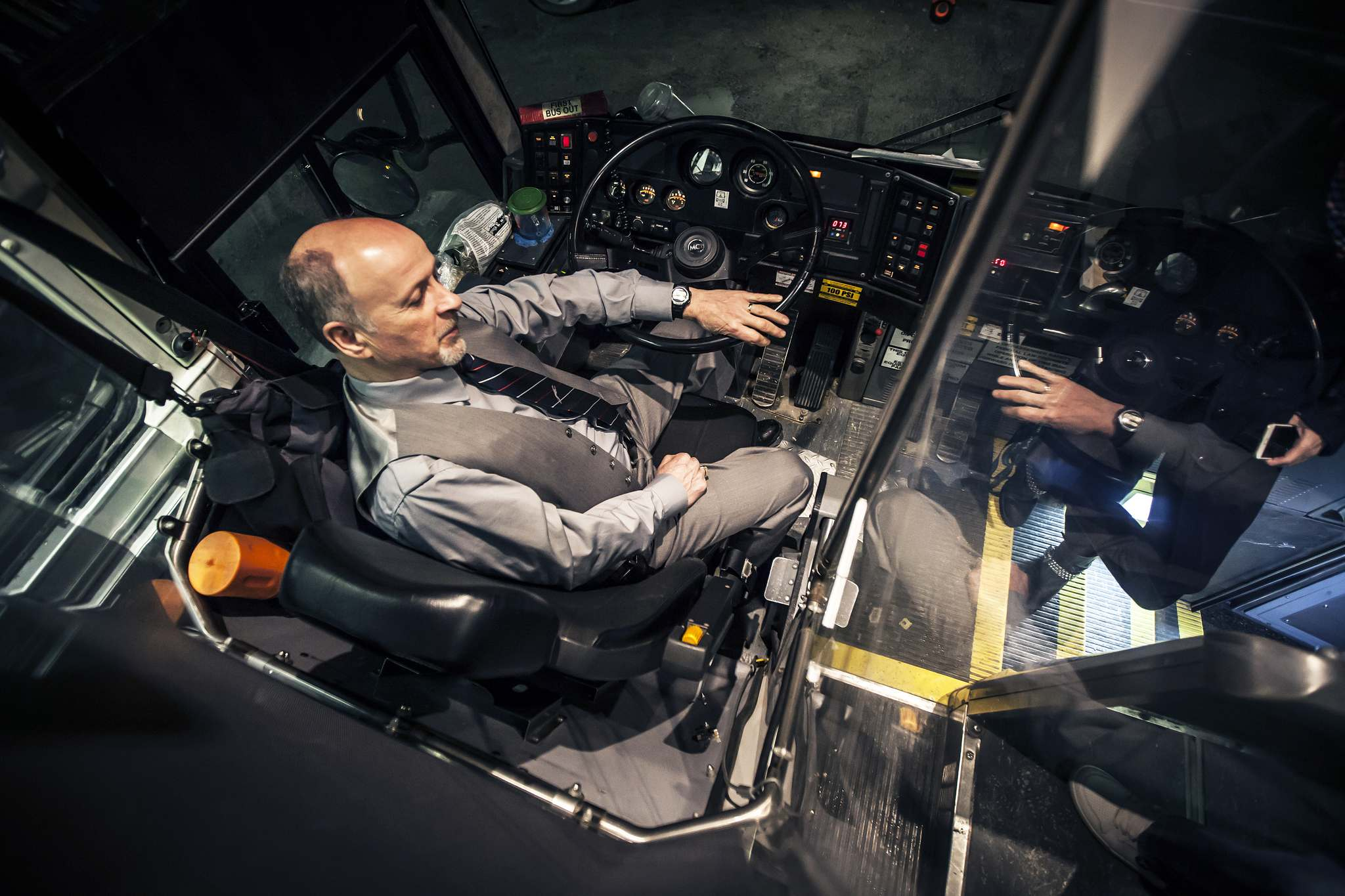 Stern sits in his cockpit and chats with a passenger.