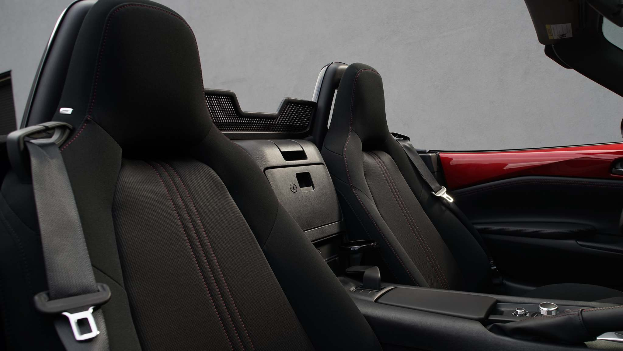 MazdaThe Mazda MX-5 features hammock-like seats in leather or cloth, that keep drivers low, comfortable and protected from the elements.