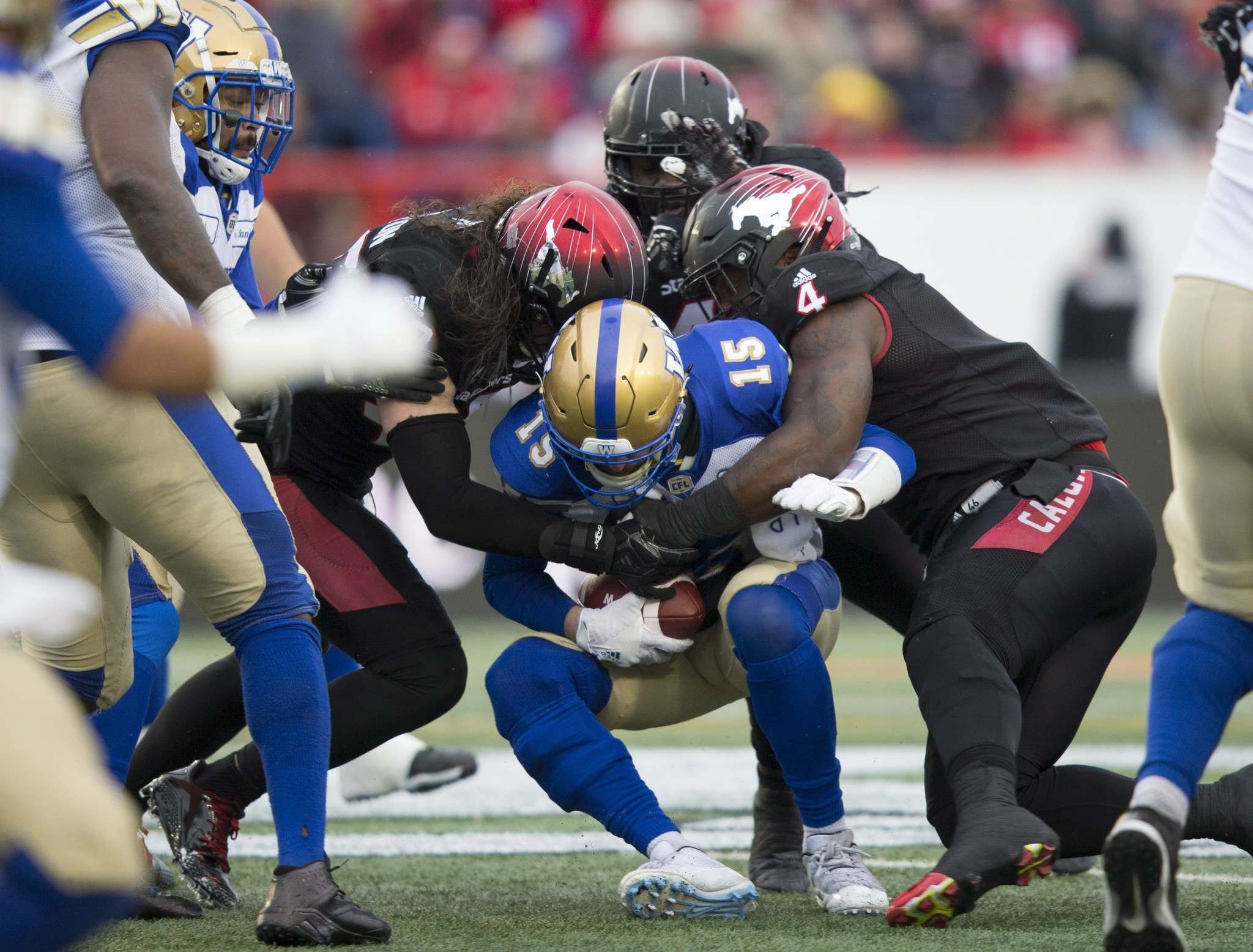 THE CANADIAN PRESS/Todd Korol</p><p>Winnipeg Blue Bombers quarterback Matt Nichols is sacked by Calgary Stampeders defenders during the first half of the West Final in Calgary, Sunday. The Bombers offence failed to score a major against a stingy Stampeders defence in the 22-14 loss.</p>