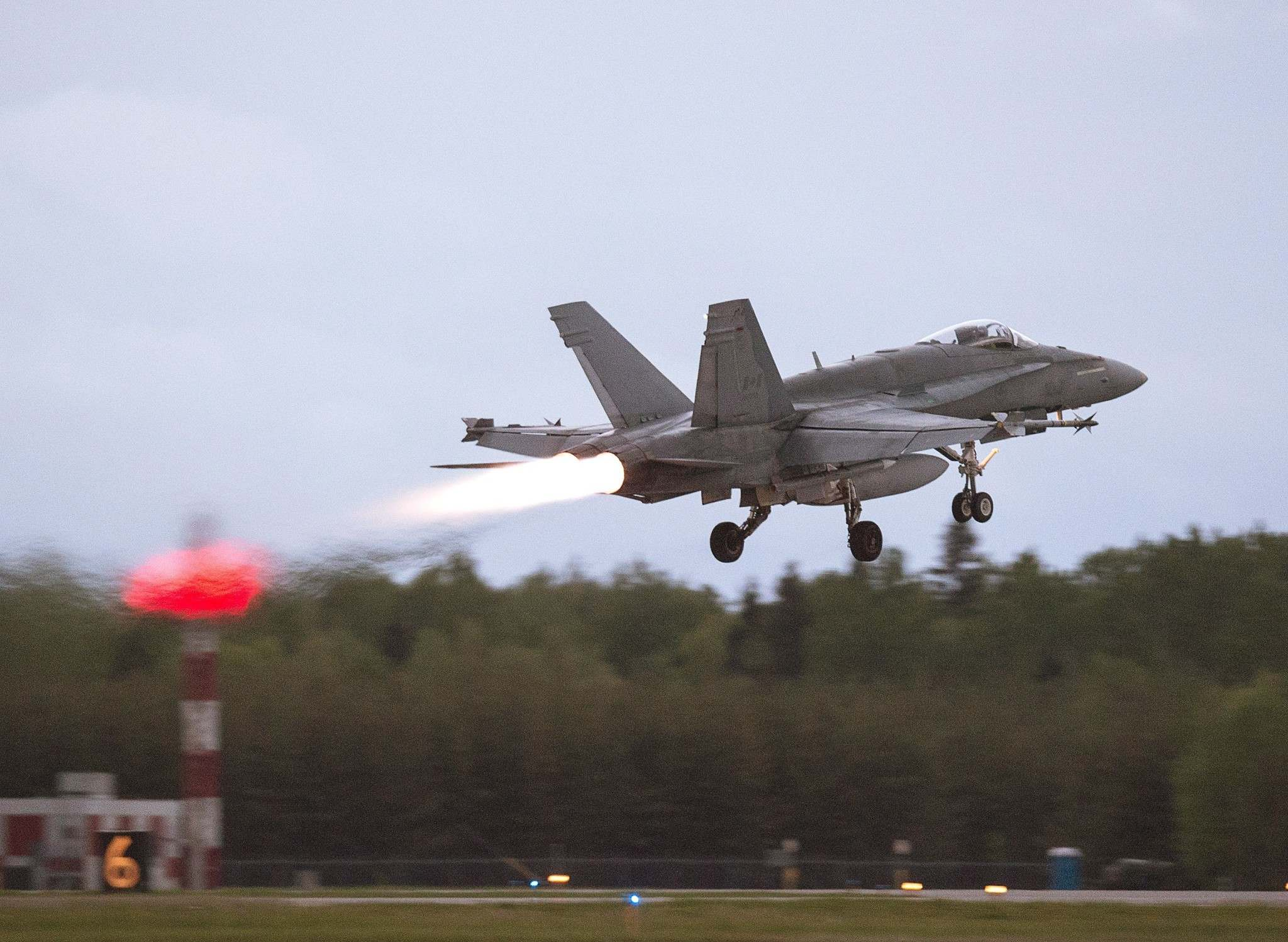 An RCAF CF-18 takes off from CFB Bagotville, Que. on Thursday, June 7, 2018. In 2016, the Liberals were planning to spend billions of dollars on 18 new Super Hornet jets to supplement Canada&rsquo;s aging CF-18 fleet. (Andrew Vaughan / The Canadian Press files)</p>
