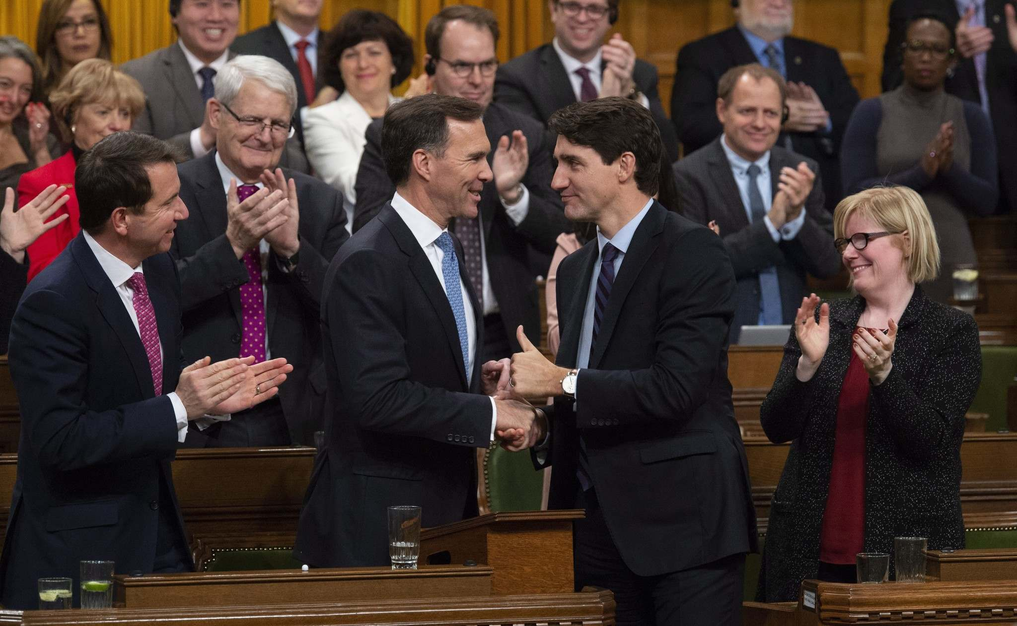 Prime Minister Justin Trudeau shakes hands with Finance Minister Bill Morneau following the fiscal economic update on Wednesday.