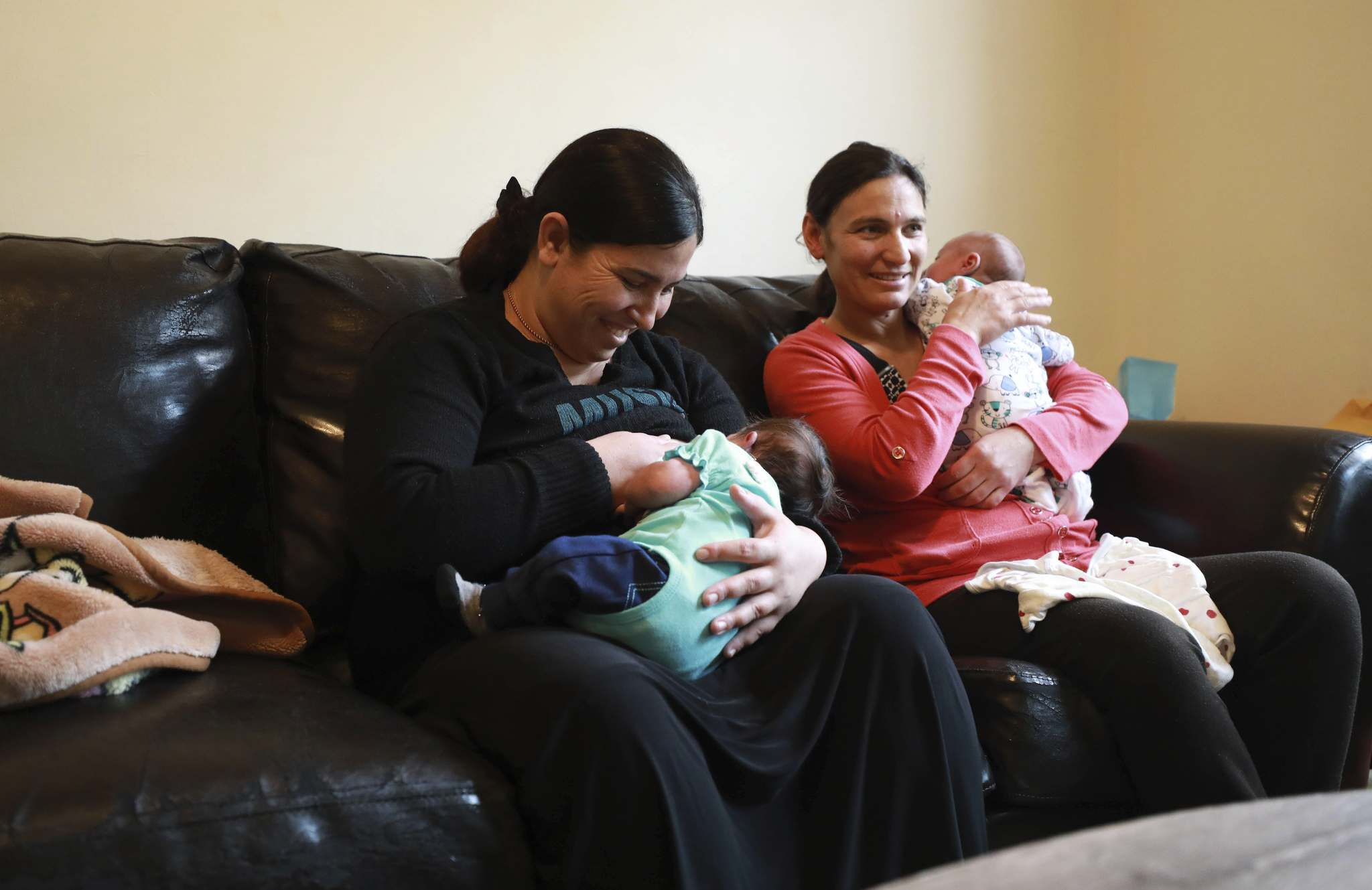 Basima Grnos (left) with her baby girl, Avin, 2 weeks. At right, Safiya Maroo with her son Sam who is 3 weeks old. (Ruth Bonneville / Winnipeg Free Press)