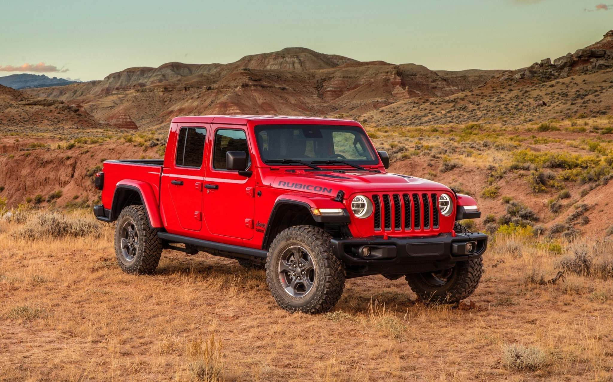 FCA The 2020 Jeep Gladiator shares a platform, interior and front end with the 2019 Wrangler, but the similarities end there. The vehicle's rear features the traditional pickup truck bed with either a hardtop roof or an optional removable soft top.