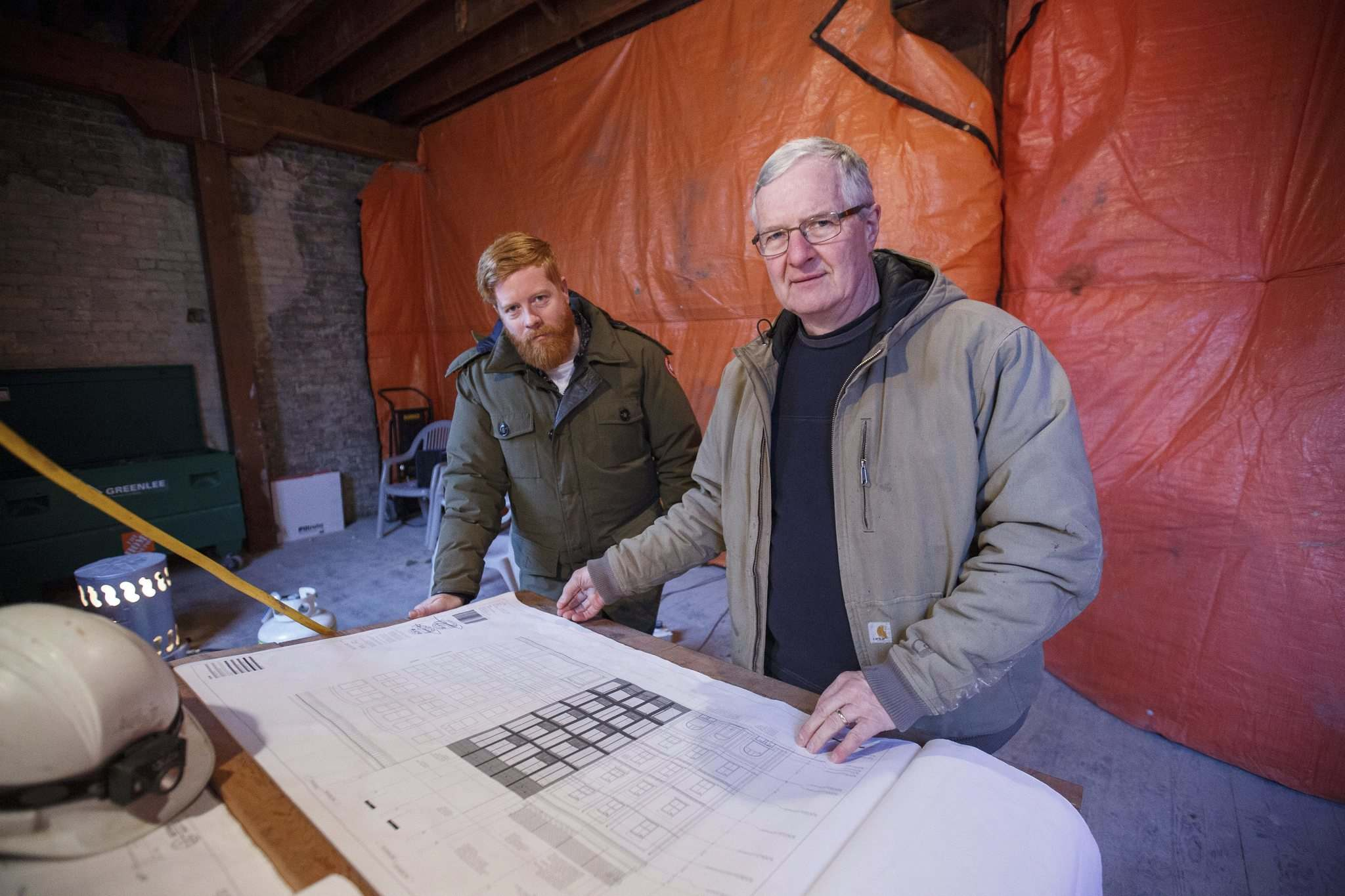 MIKE DEAL / WINNIPEG FREE PRESS</p><p>Alex Boersma (left), co-developer of Warehouse 1885 and site manager Henry Wiebe pore over construction drawings for the 39-unit residential development at 104 and 108 Princess Ave.</p>