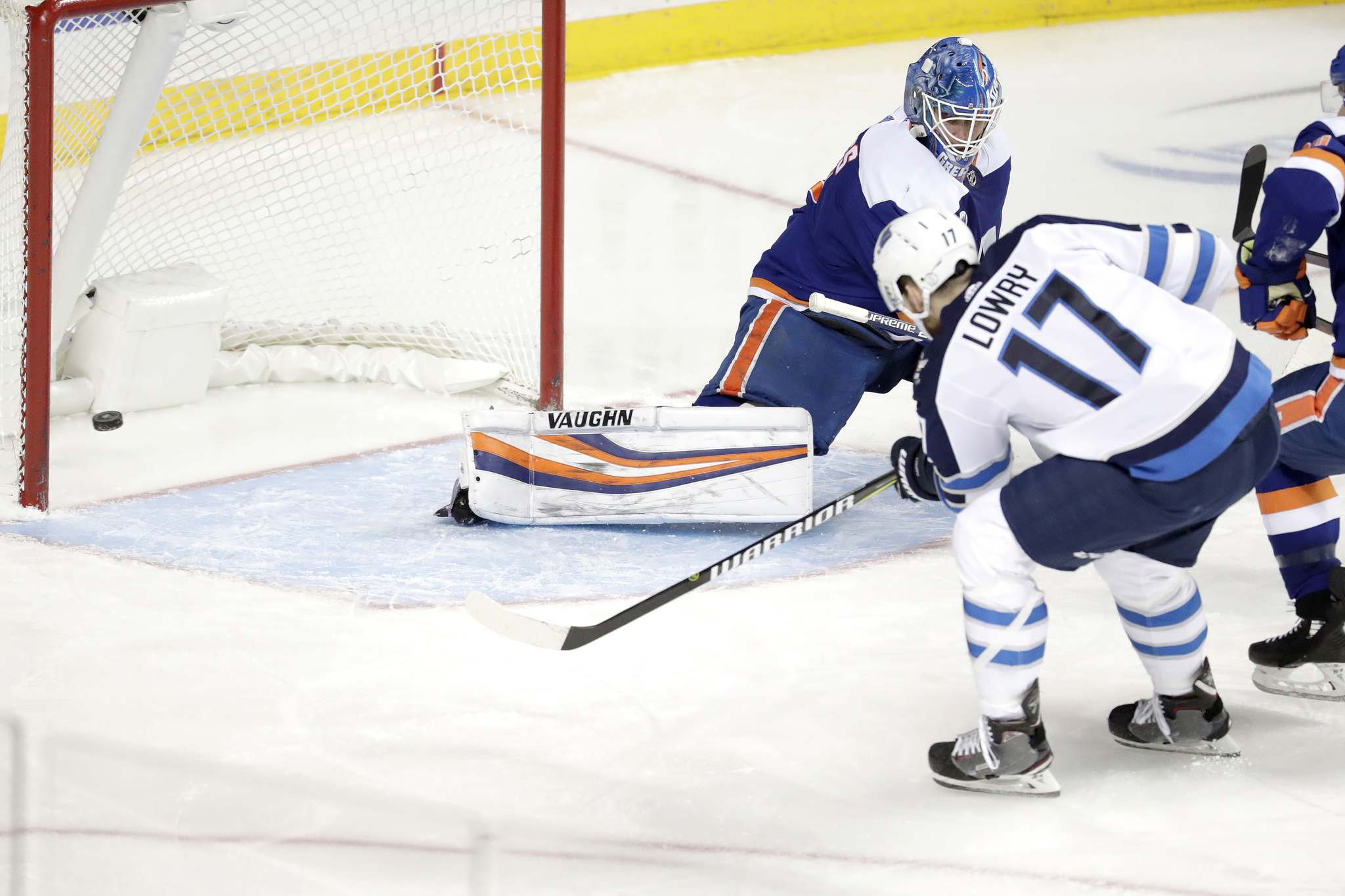 Adam Lowry got the game winner Tuesday against the New York Islanders 22 seconds after Jacob Trouba got the Jets on the board. (Julio Cortez / The Associated Press)</p>