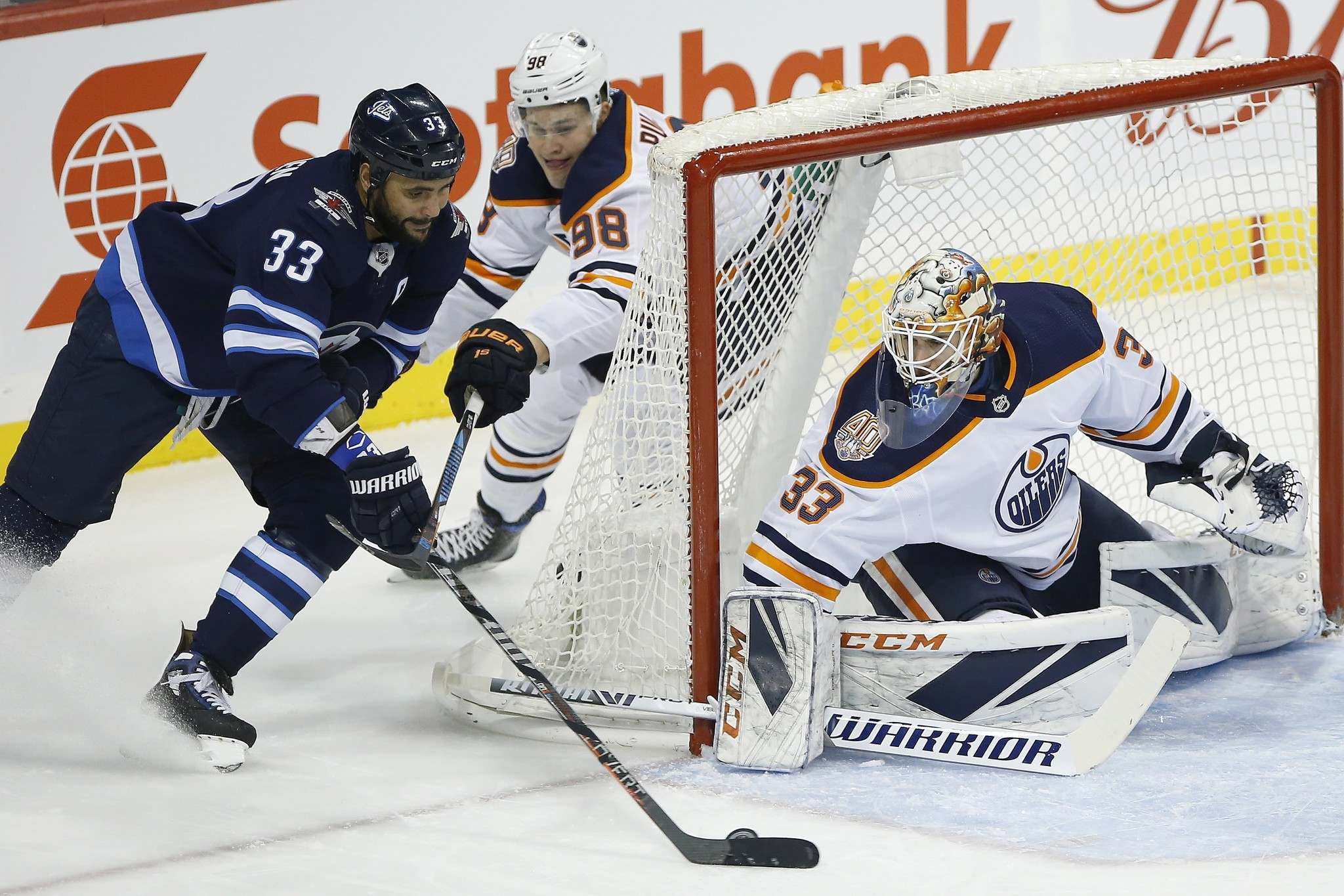 <p>Winnipeg Jets defenceman Dustin Byfuglien attempts a wraparound against Edmonton Oilers goaltender Cam Talbot on Thursday. Big Buff is on course for his best offensive season.</p>