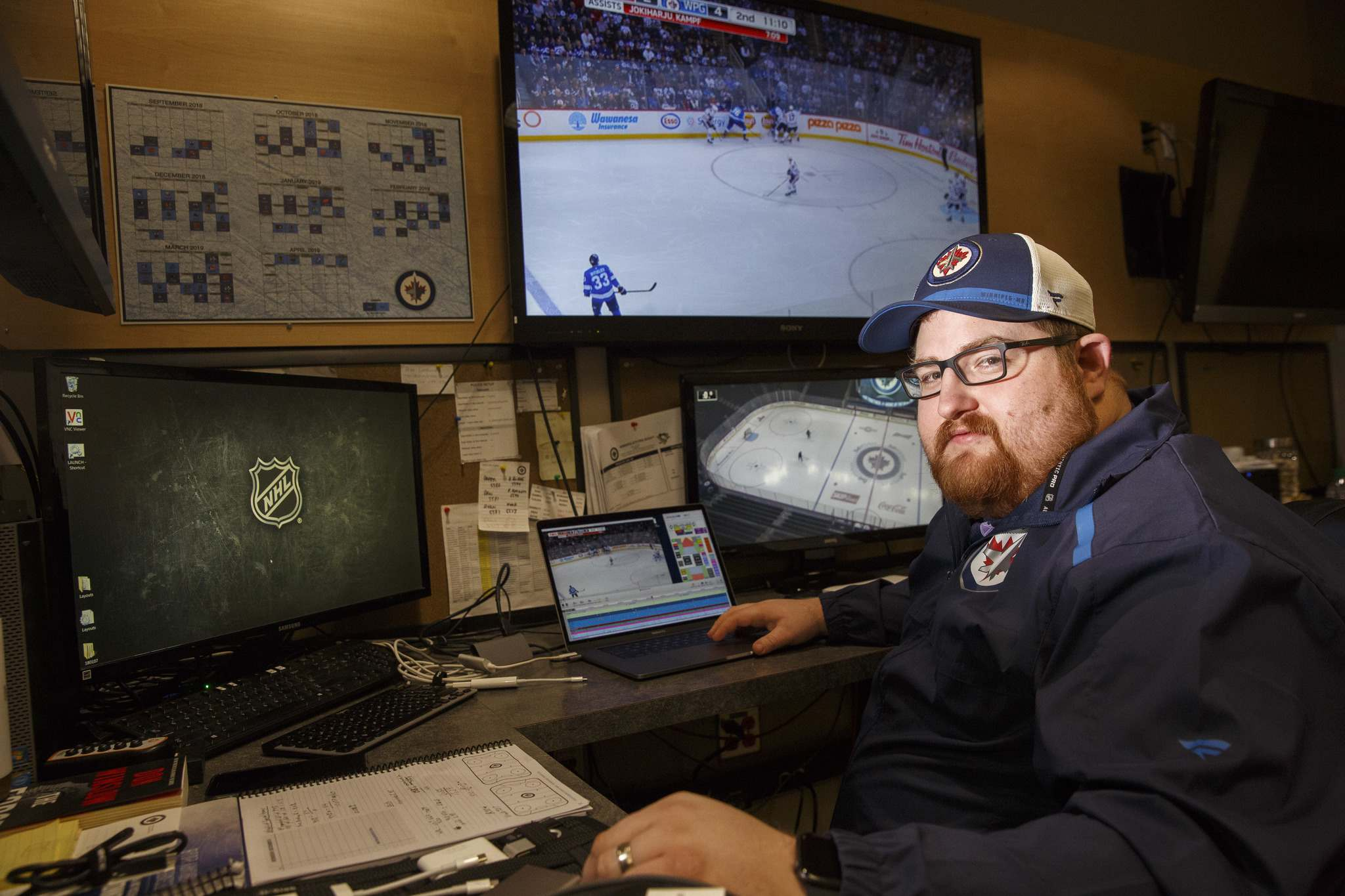 Winnipeg Jets video coach Matt Prefontaine works in his office by the Winnipeg Jets dressing room at Bell MTS Place. (Mike Deal / Winnipeg Free Press)