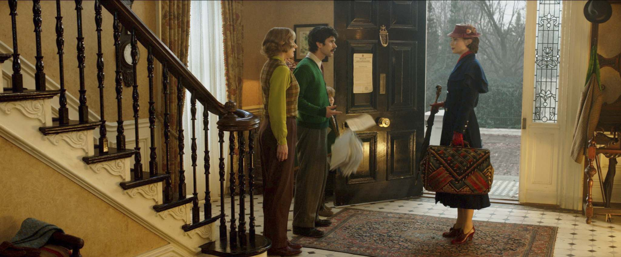 Emily Blunt (right) is Mary Poppins, who falls from out of the sky to again help the Banks family, Michael (Ben Whishaw, centre) and Jane (Emily Mortimer). (Disney)