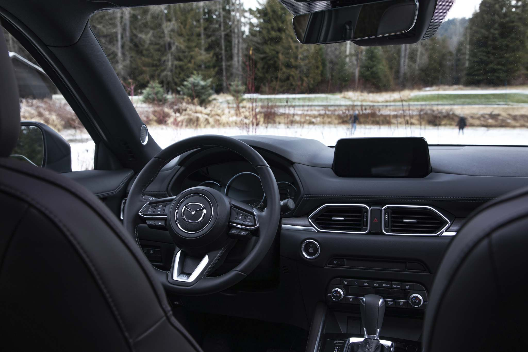 Mazda's interiors are arguably competitive with premium brands.