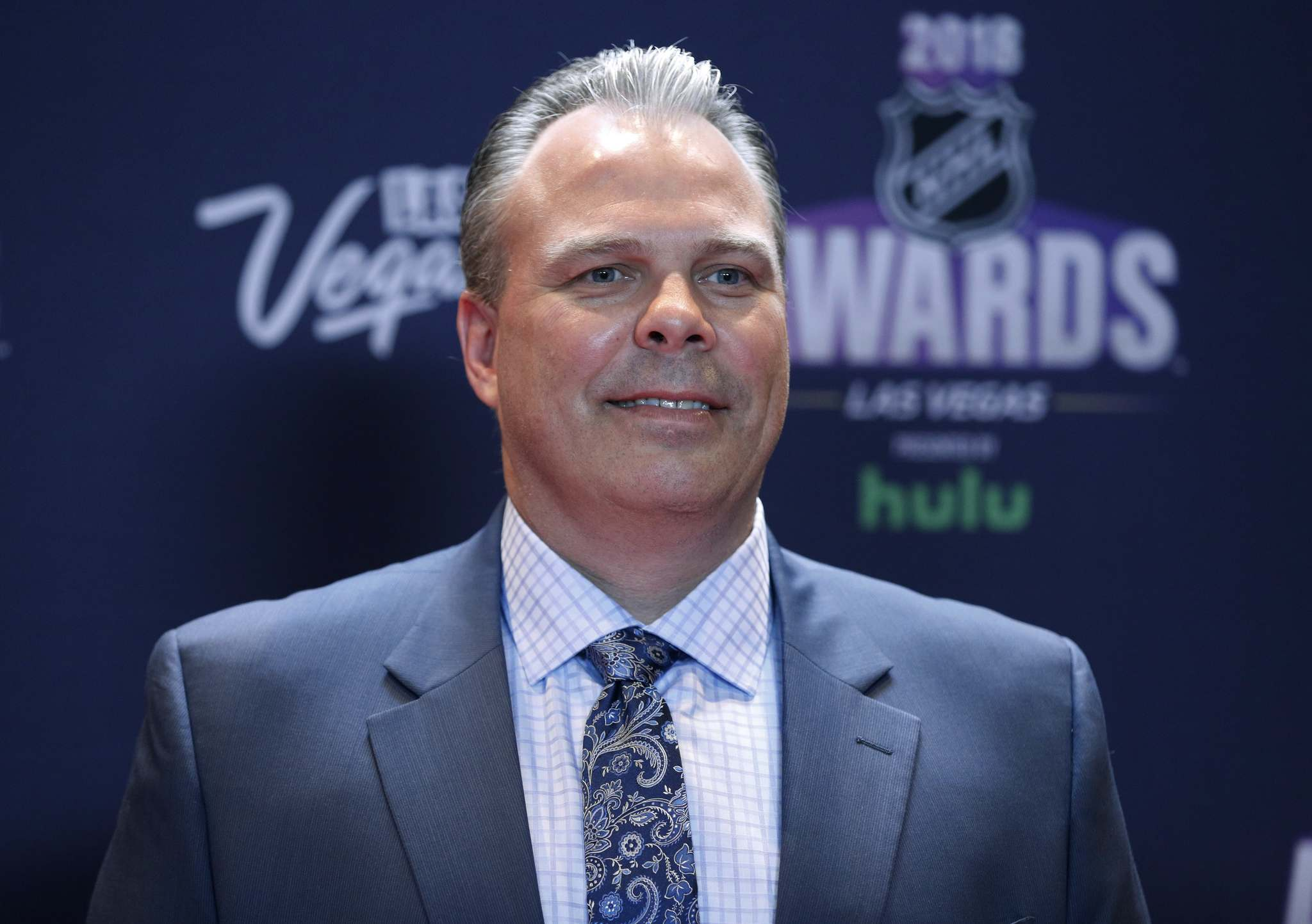 Kevin Cheveldayoff is fine with the NHL's playoff system, despite having some top-tiered teams playing each other in early rounds. (John Locher / The Associated Press files)</p>