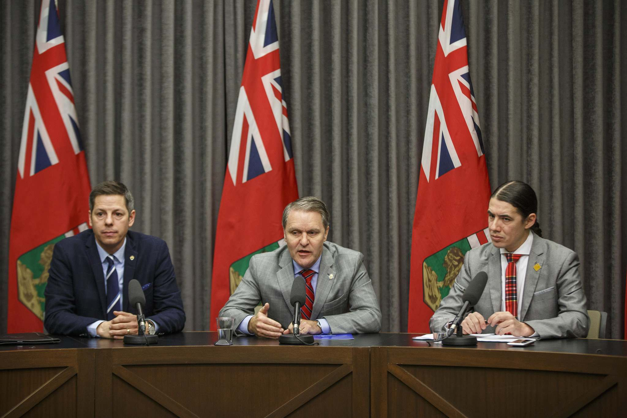 Winnipeg Mayor Brian Bowman (from left), Manitoba Health Minister Cameron Friesen and Winnipeg Centre MP Robert-Falcon Ouellette announced the formation Tuesday of a tri-level task force to deal with the province's meth crisis. (Mike Deal / Winnipeg Free Press)</p></p>