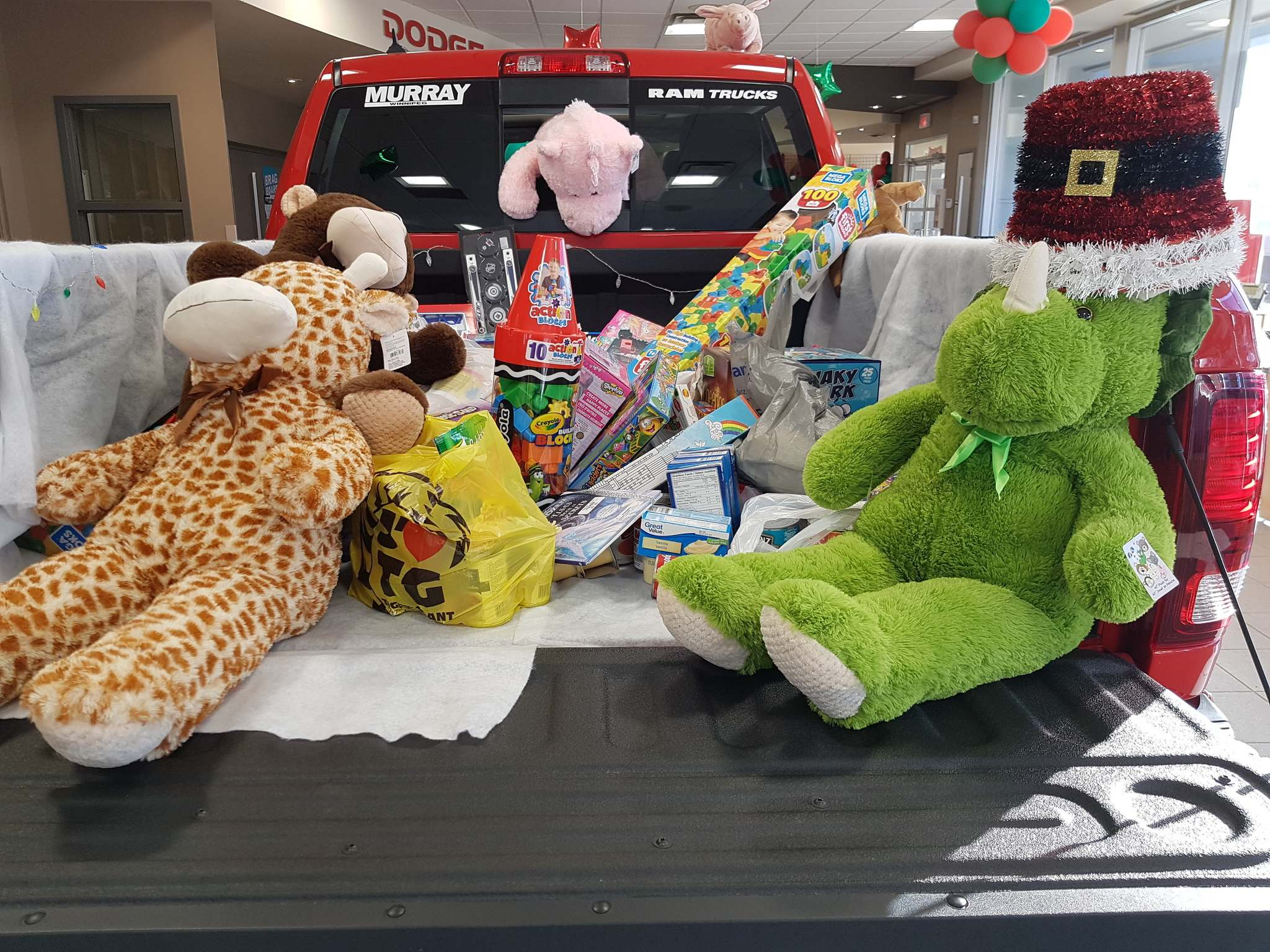 SuppliedMurray Chevrolet and Murray Chrysler Dodge Jeep Ram filled trucks with Christmas presents for the less fortunate, including toys for kids.