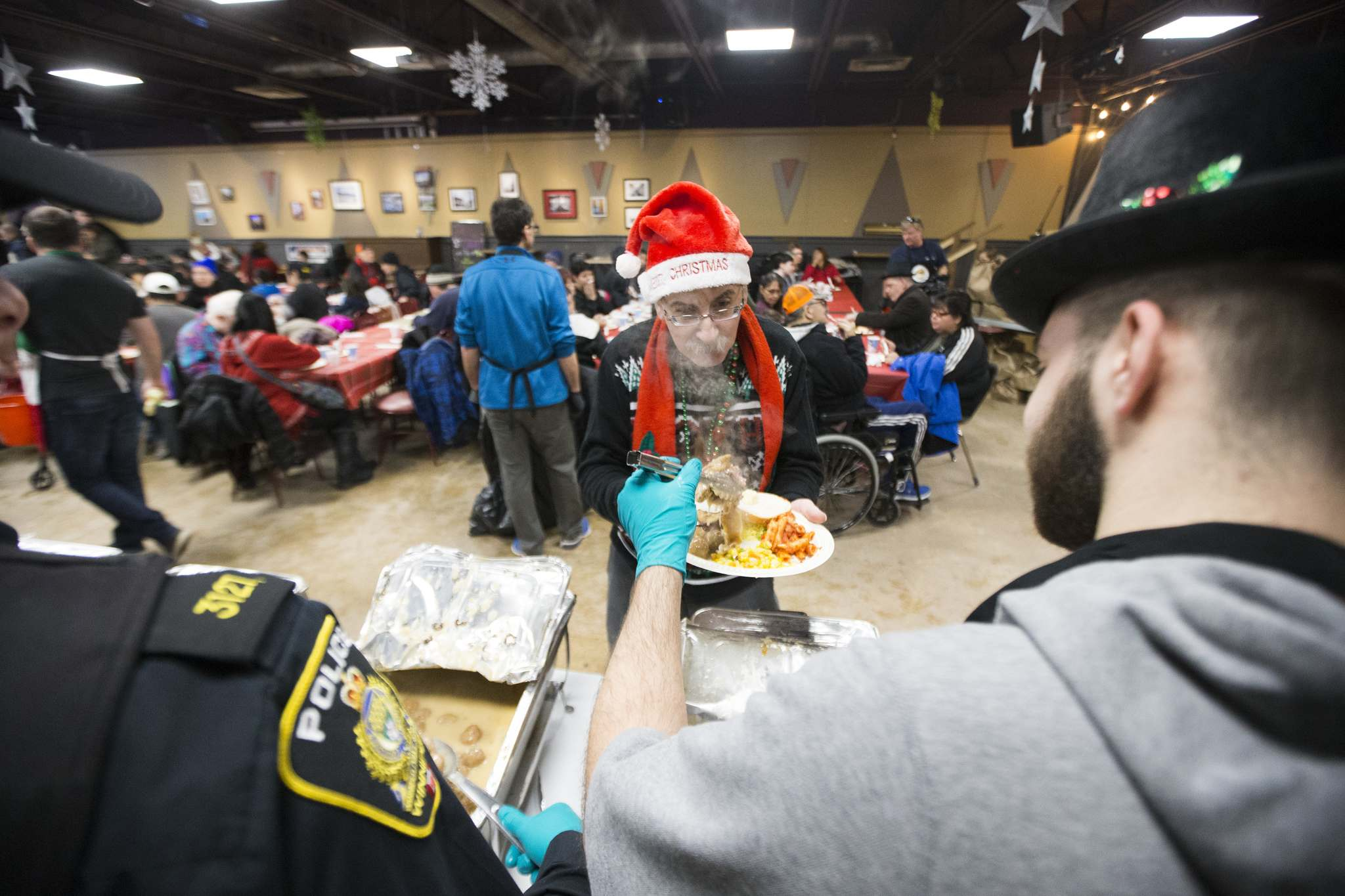 MIKAELA MACKENZIE / WINNIPEG FREE PRESS</p><p>Barry Kopulos is served at the 13th Annual Christmas Eve Feast.</p>