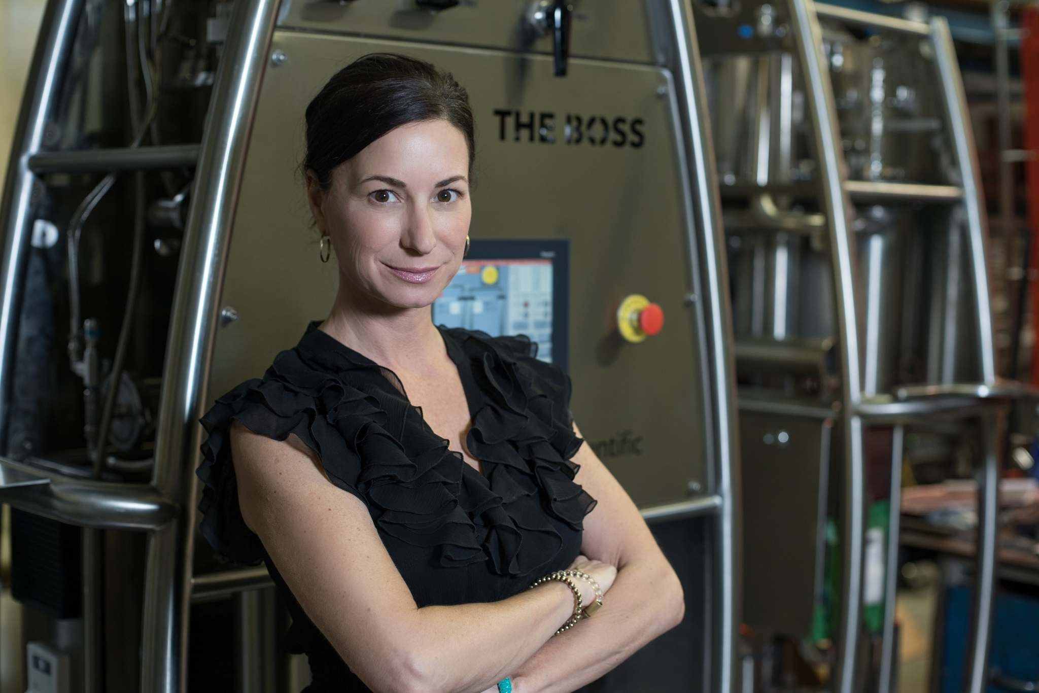 Quadron Cannatech Corp. CEO and director Rosy Mondin in front of one of the company's cannabis extraction systems, which uses carbon dioxide to process marijuana bud into concentrated oil. (Supplied)</p>