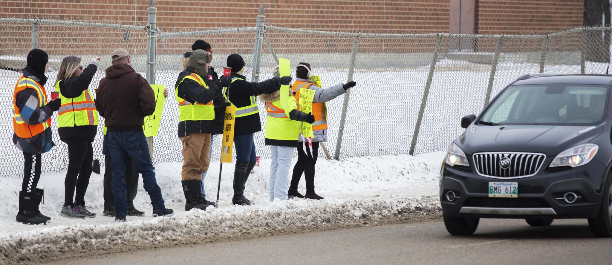 Chelsea Kemp / The Brandon Sun</p><p>Yellow Vest protesters hold rally signs as they wait for a protest trucker convoy from Virden Saturday.</p></p>