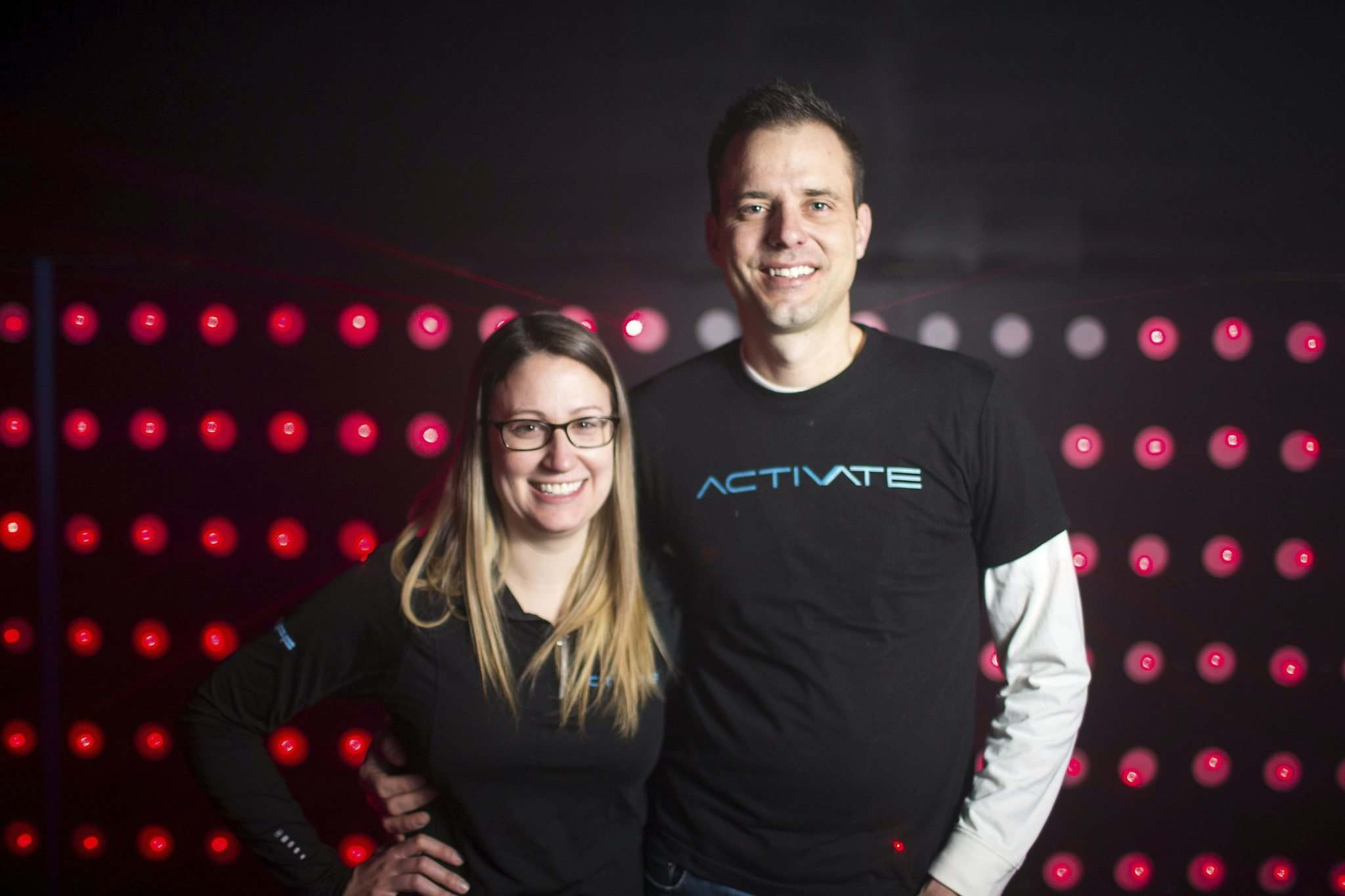 Megan and Adam Schmidt are ready to give Winnipeggers a new indoor gaming experience at Activate Games. (Mikaela MacKenzie / Winnipeg Free Press)