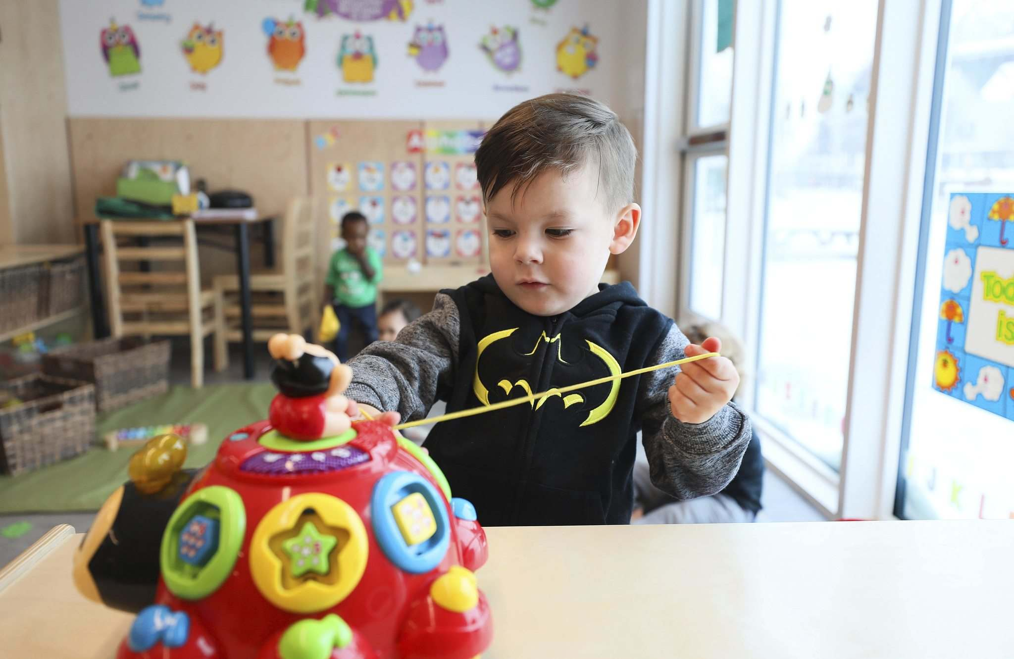 RUTH BONNEVILLE / WINNIPEG FREE PRESS</p><p>Three-year-old Renly Davidson plays with toys at the newly expanded Campus Children's Centre at U of M's Fort Garry campus.</p>