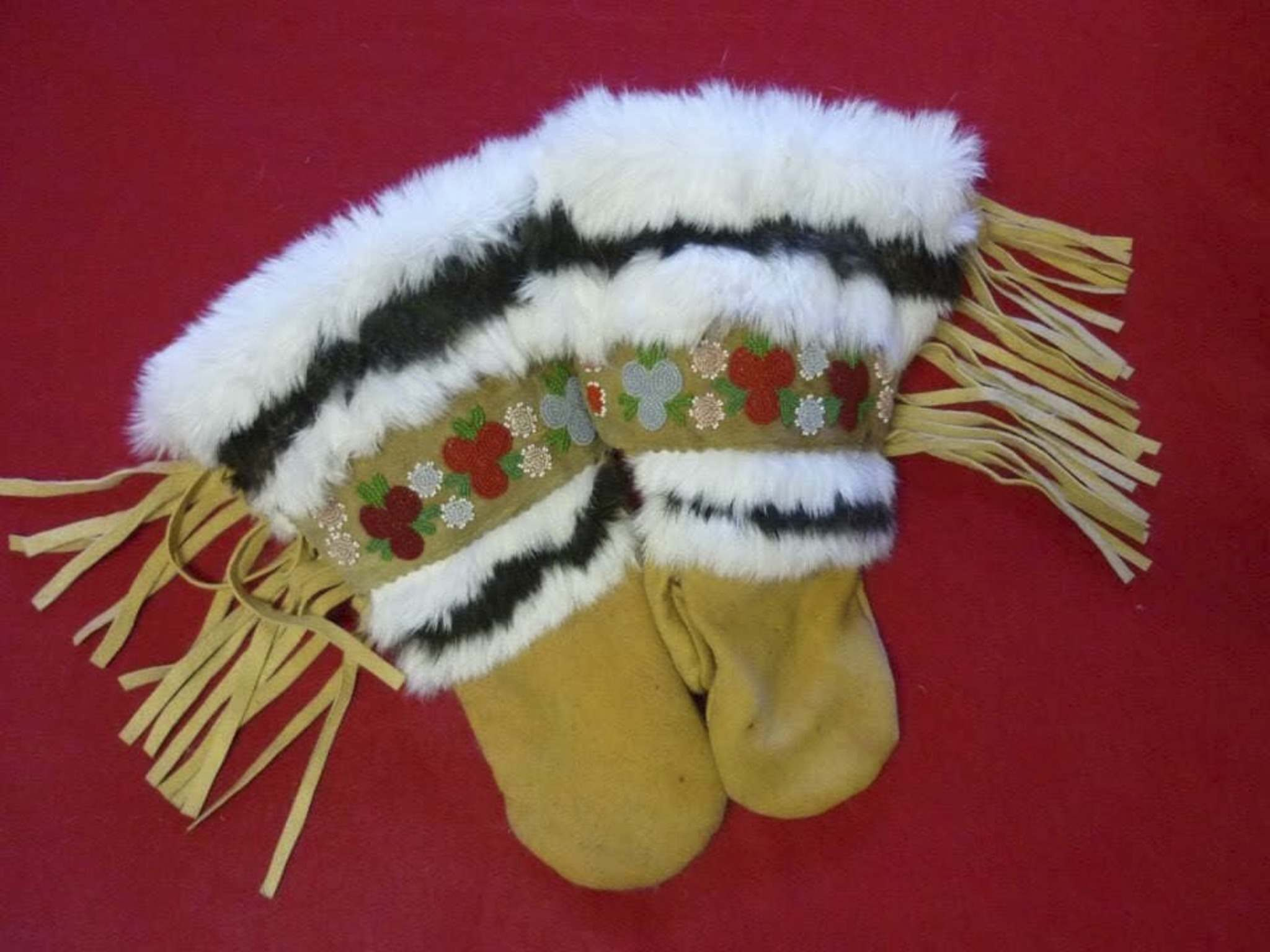 Froese used his grandmother's beadwork on the mitts. (Facebook)