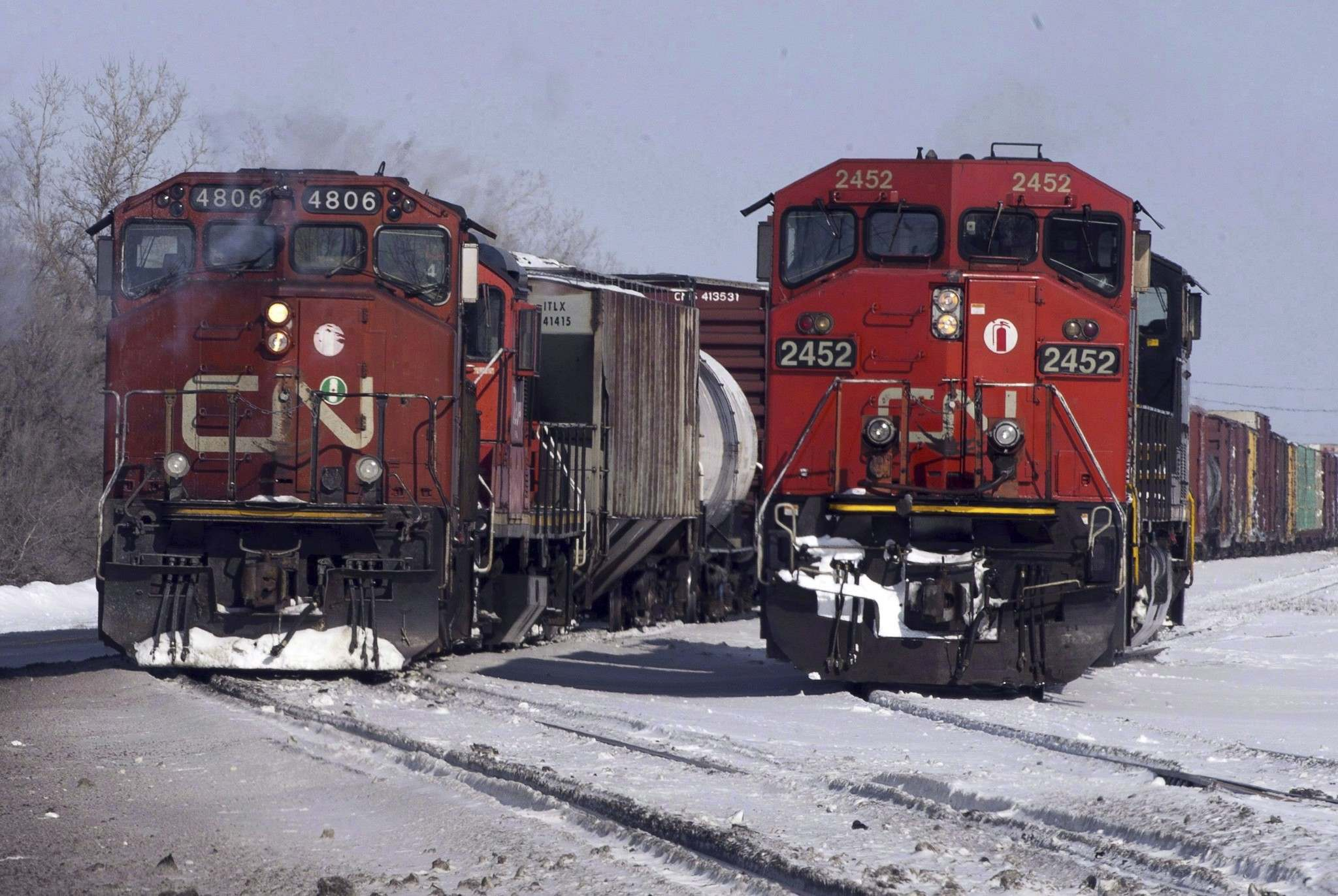 <p>Canadian National Railway locomotives in Montreal. During an historic increase in oil transport by train, Ottawa is giving vague guidelines on how to update the rules on how long staff can safely be on-shift.</p>