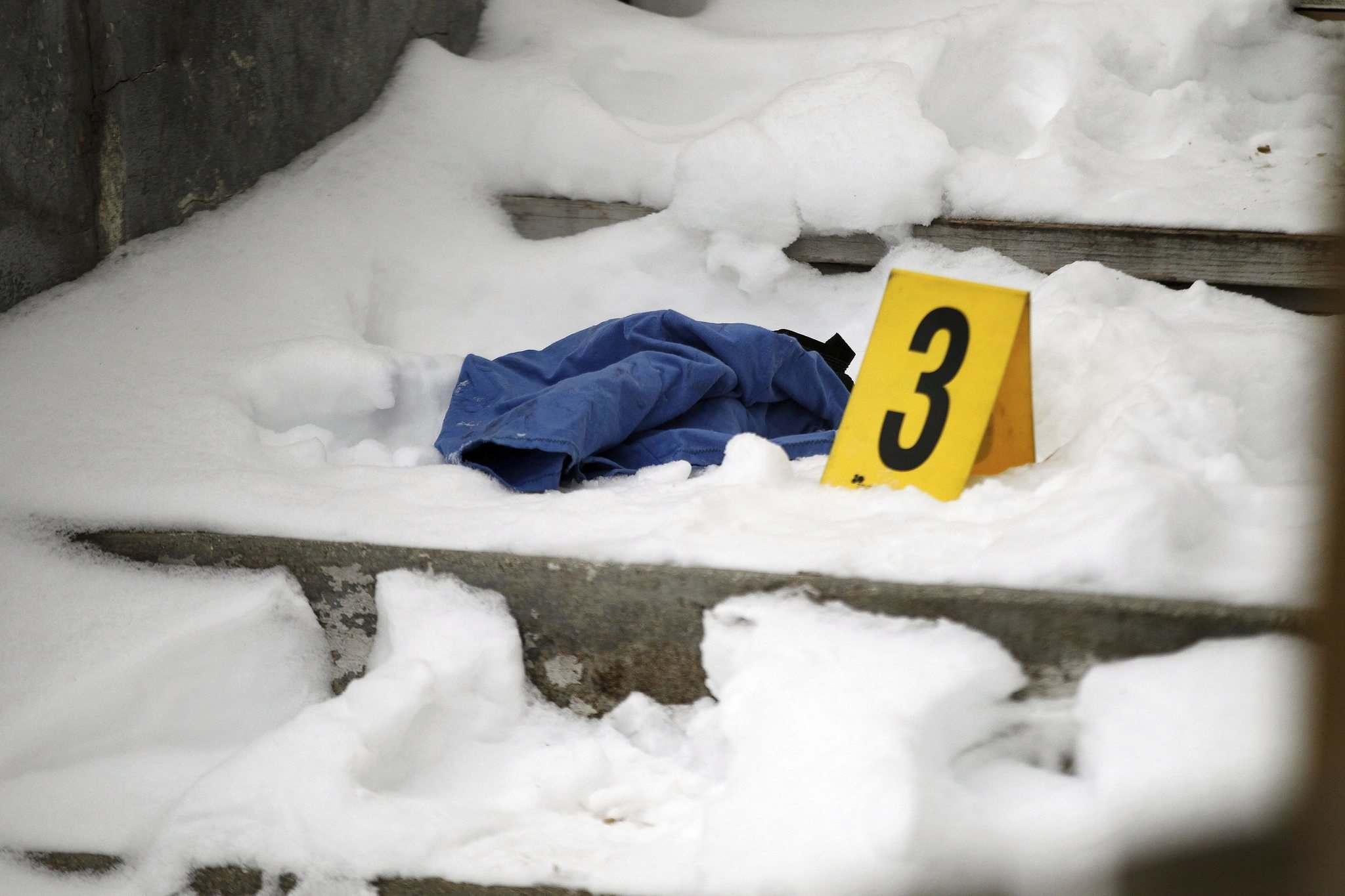 A small blue garment on the front step of a house at 548 Sherbrook is marked as evidence in the Friday night police shooting.