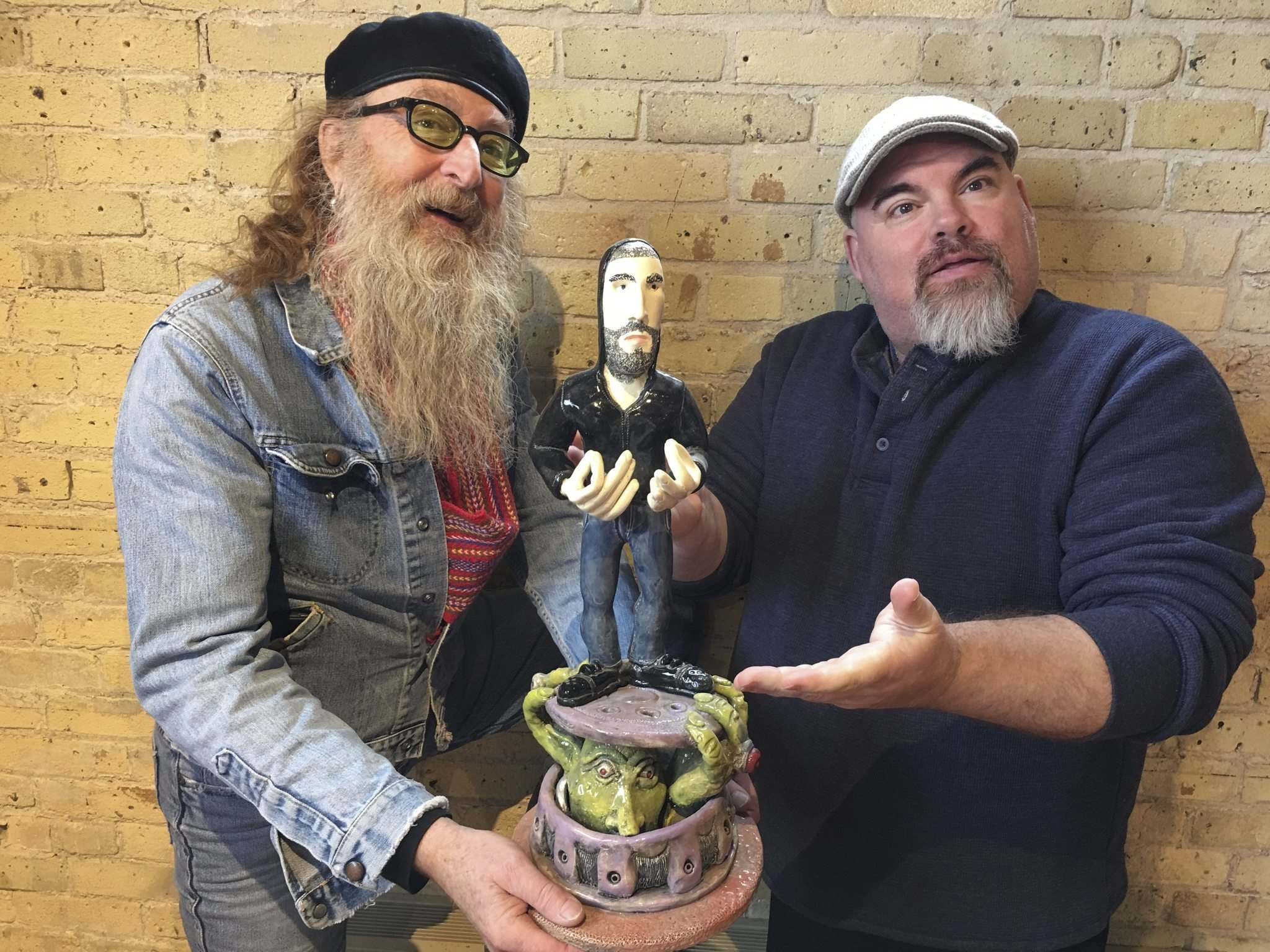 photos SUPPLIED</p><p>Artist Jordan Van Sewell (left) and comedian Big Daddy Tazz show off Van Sewell's Darcy Oake sculpture that will be auctioned off.</p>