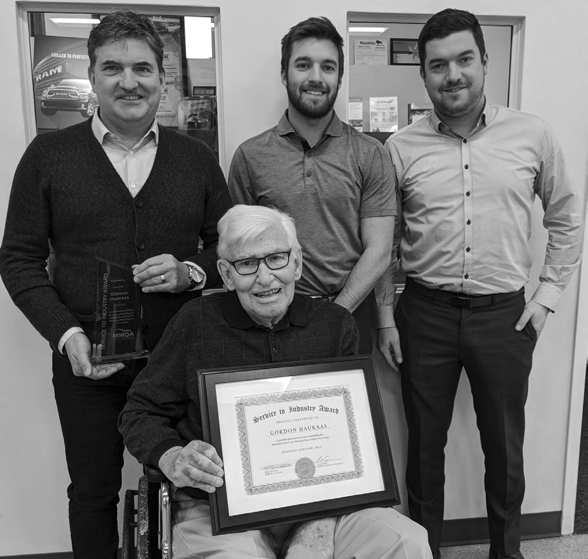 Founder of The Pas' Twin Motors, Gordon Haukaas (front), who was presented with a Service to Industry Award, pictured with Murray (from left), Ty and Brett Haukaas.