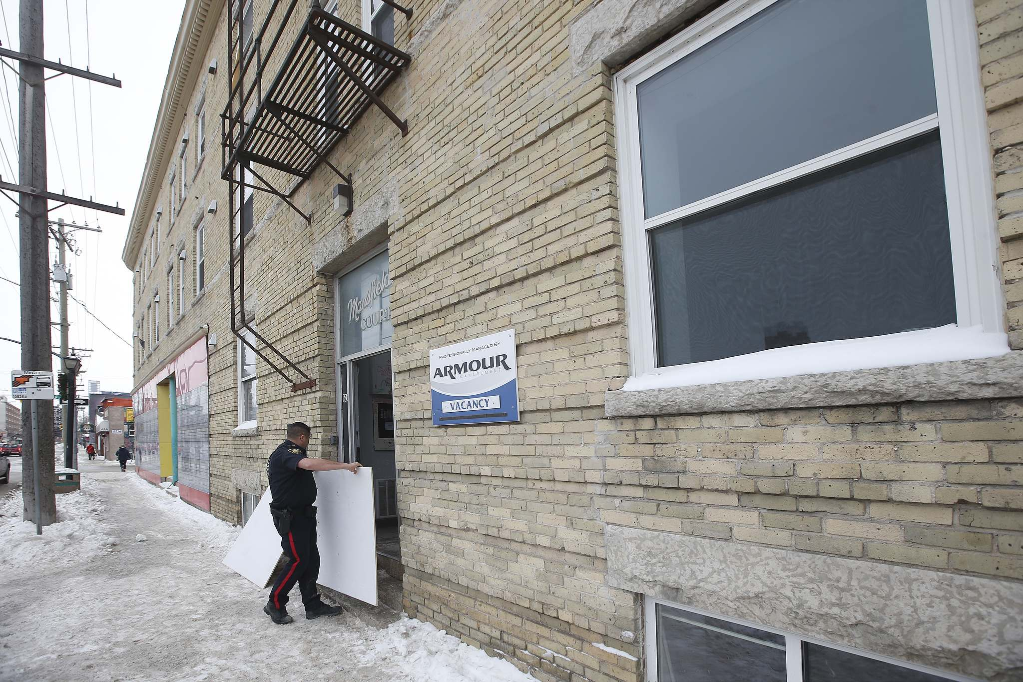 On Jan. 13, one person was taken to hospital and 30 others were left homeless after a fire in this apartment block on Ellice Avenue at Maryland Street. (John Woods / Winnipeg Free Press)