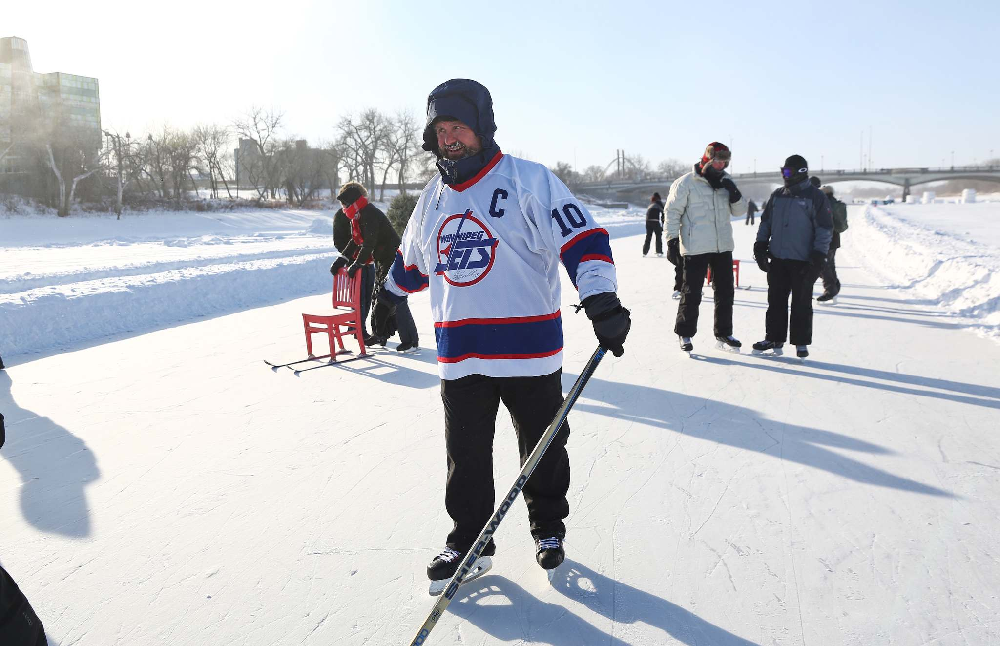 James Hatch, a former U.S. Navy SEAL from Virginia, takes to the ice near The Forks after accepting a bet he couldn't win.
