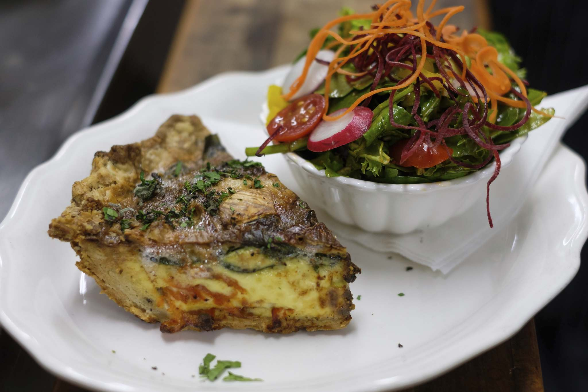 Rest Gare&rsquo;s Quiche with a side of House Salad.</p>