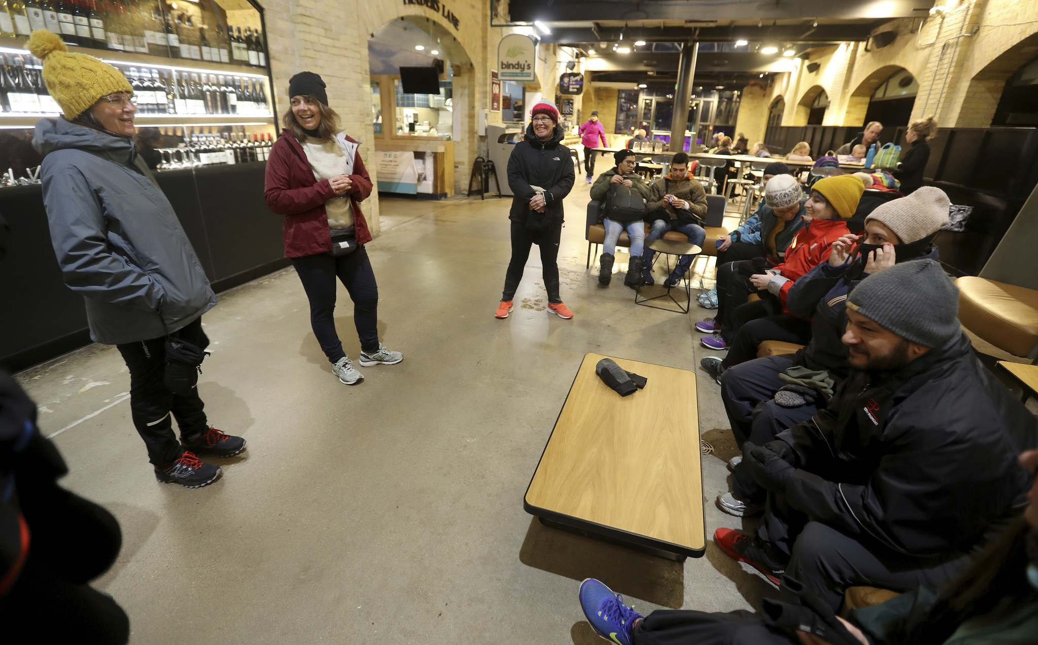 Somers and the members of a run club prep to brave the ourdoor elements. (Trevor Hagan / Winnipeg Free Press)