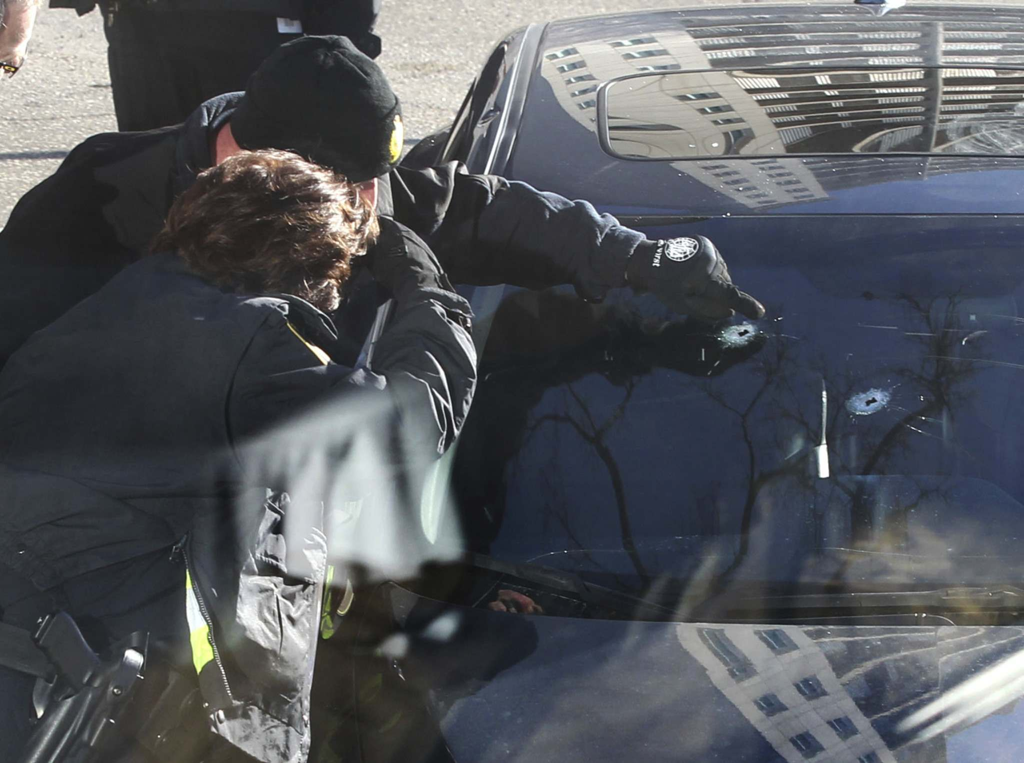 RUTH BONNEVILLE / WINNIPEG FREE PRESS FILES</p><p>Police Identification officers investigate the scene of a drive-by shooting on Stradbrook Ave. that claimed the life of Theodoros (Teddy) Belayneh in November, 2016.</p>