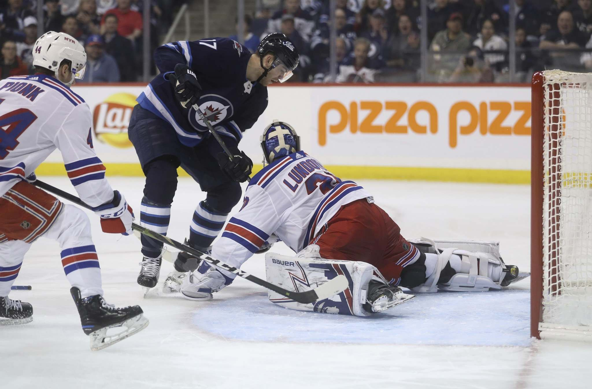 Trevor Hagan / The Canadian Press files</p><p>Jets centre Adam Lowry&rsquo;s scoring attempt is stopped by Rangers goalie Henrik Lundqvist on Tuesday.</p>