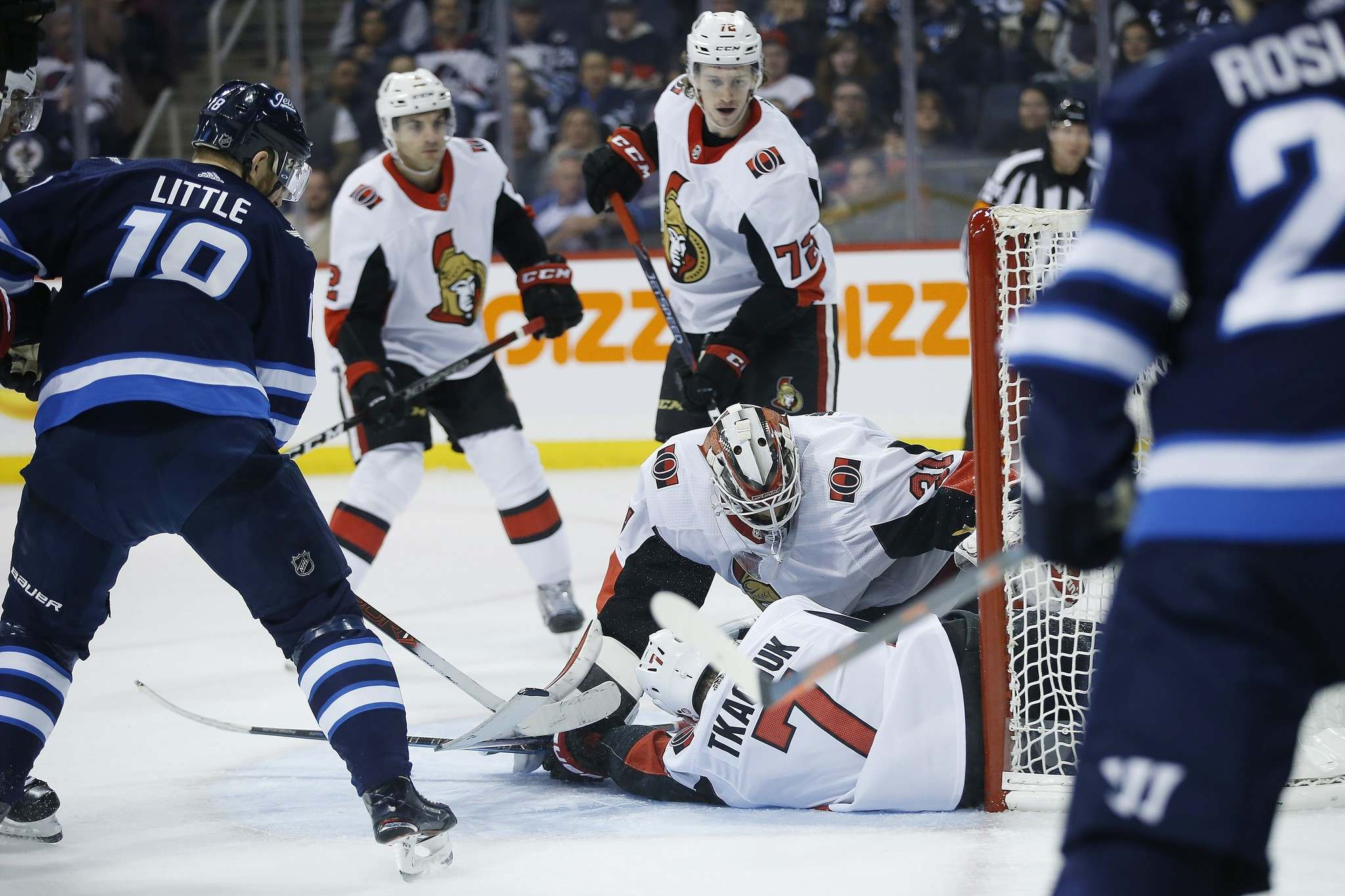 Winnipeg Jets' Bryan Little (18) looks on as Ottawa Senators goaltender Anders Nilsson (31) and Brady Tkachuk (7) smother his shot during second period NHL action in Winnipeg on Saturday, February 16, 2019. THE CANADIAN PRESS/John Woods</p>