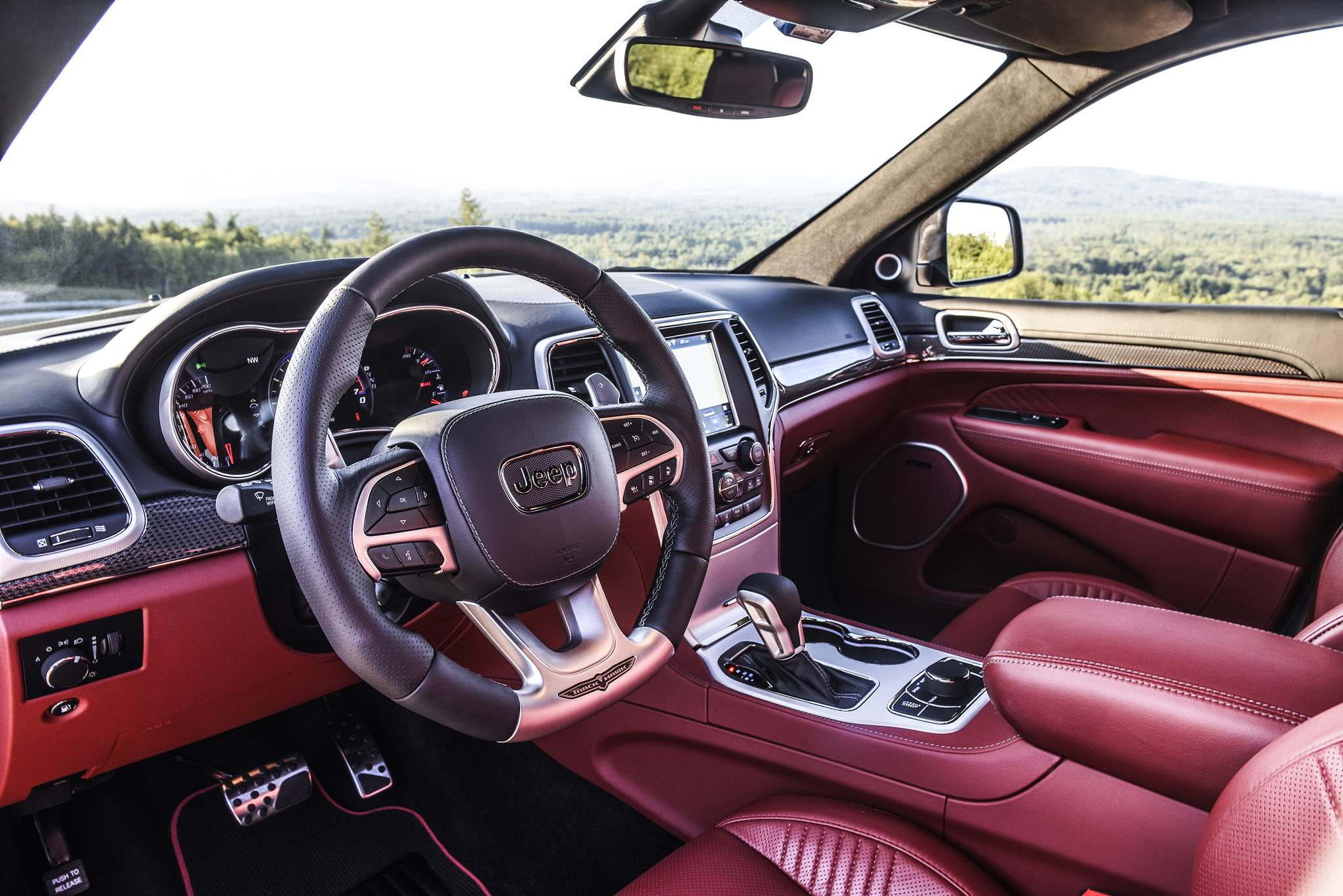 The Trackhawk's interior is uncluttered and the dash features an 8.4-inch touch screen.