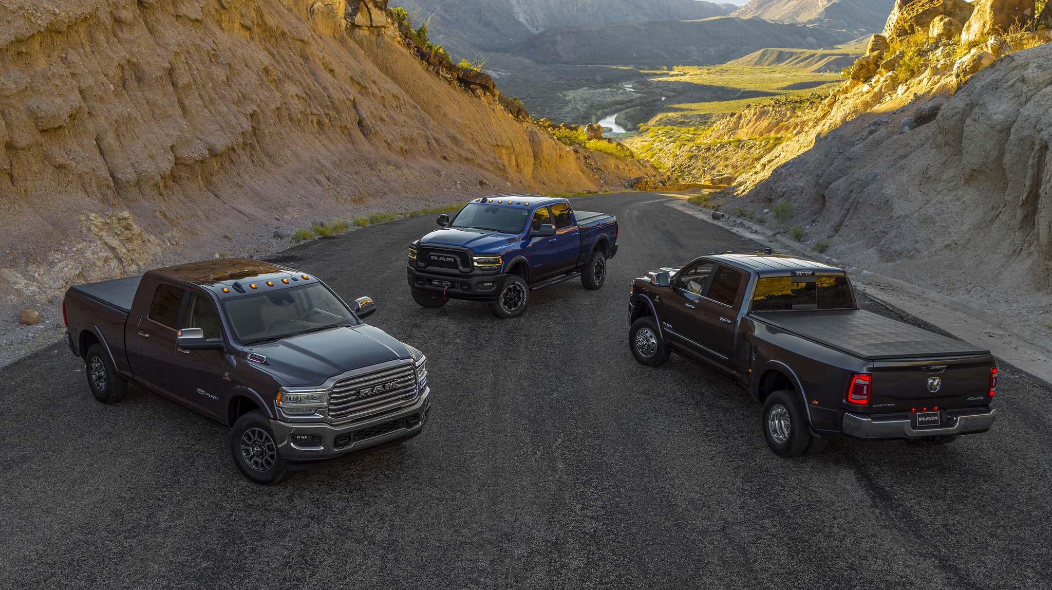 Photos by FCAThe 2019 Ram lineup includes the 2500 Heavy Duty Longhorn Mega Cab (from left), Power Wagon and 3500 Heavy Duty Limited Crew Cab Dually.