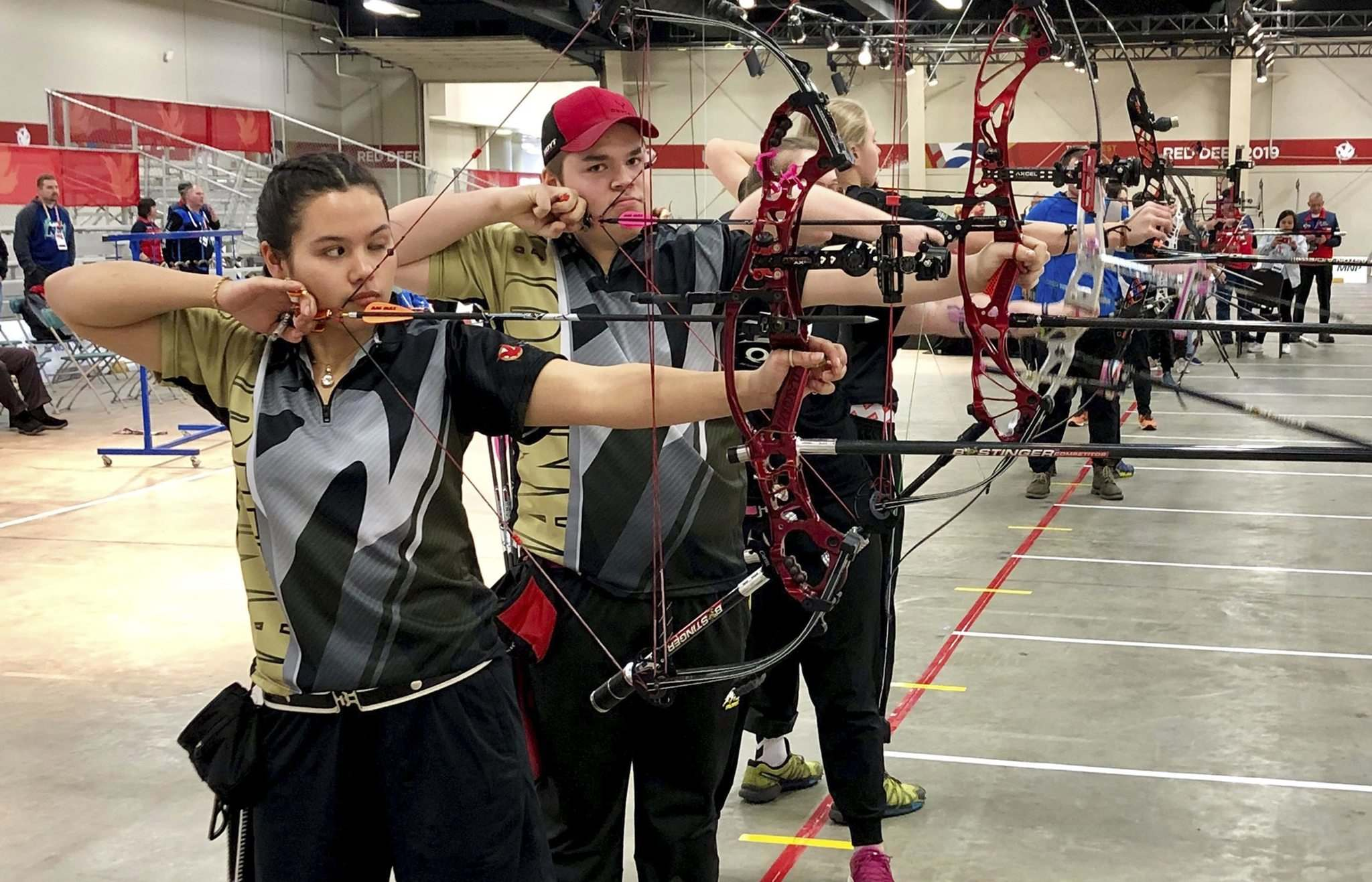 WPotrebka Photography</p><p>Archers Bryanne Lameg (from left) and Austin Taylor are two medal hopefuls for Manitoba at this week's Canada Winter Games in Red Deer, Alberta.</p>