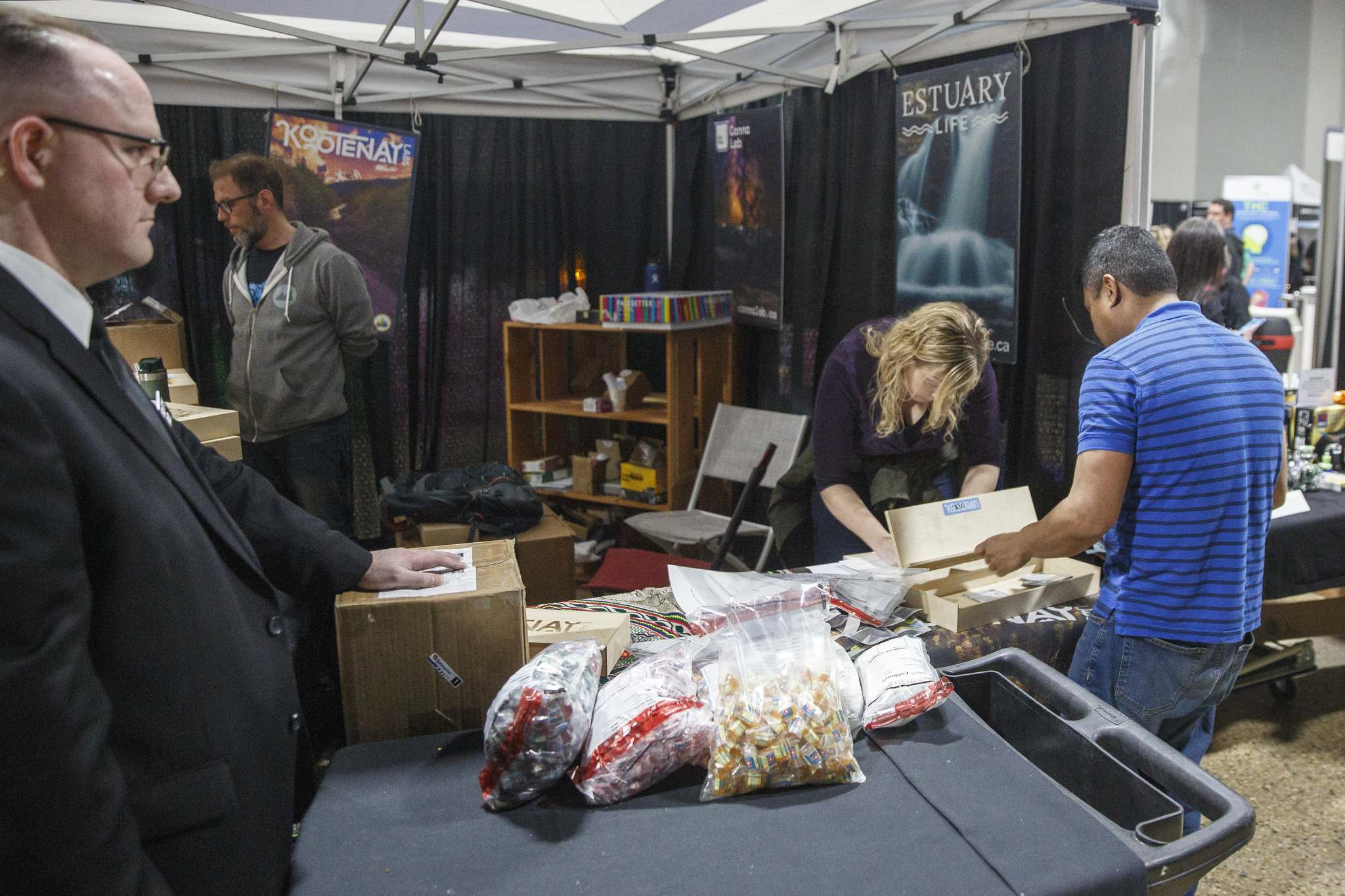 Investigators pack up illegal edible products that contain THC at the Hempfest Canada Expo at the RBC Convention centre Saturday afternoon. (Photos by Mike Deal / Winnipeg Free Press)