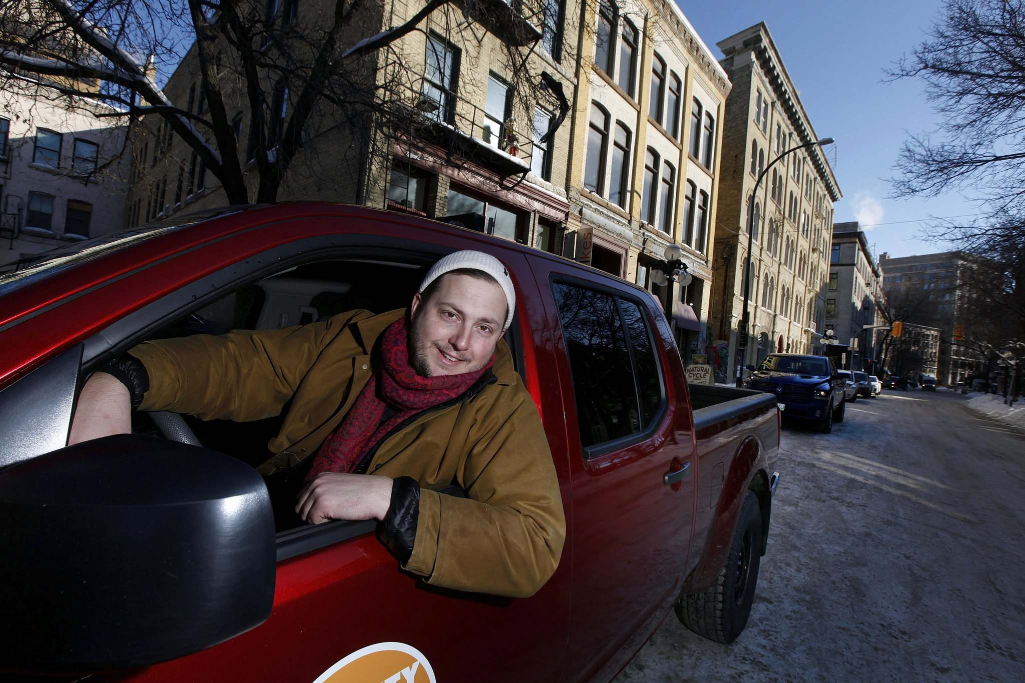 Peg City Co-op operations manager Philip Mikulec says two reasons people join the car-sharing co-op is for environmental and financial reasons. (Phil Hossack / Winnipeg Free Press)