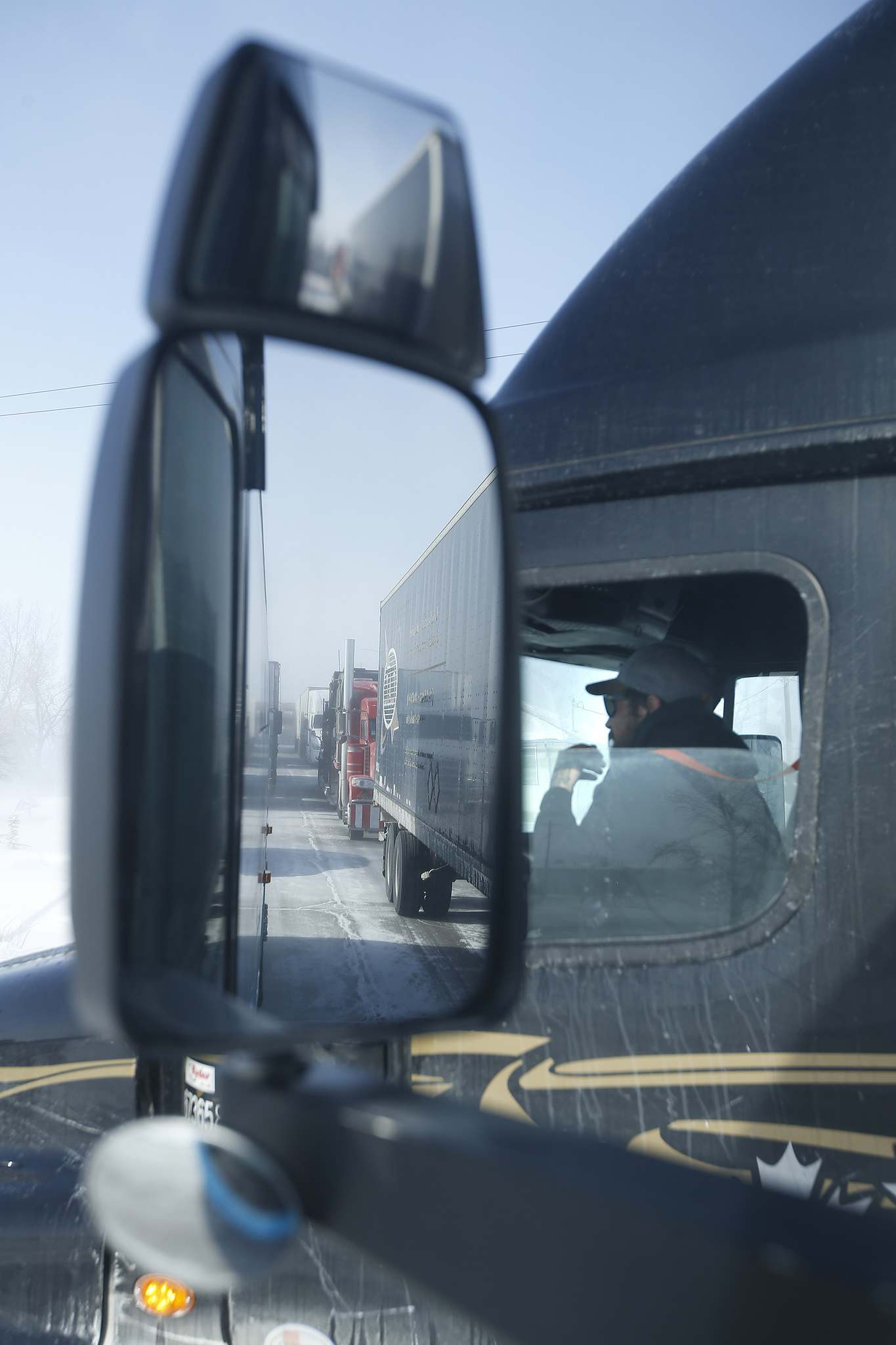 Hamelin and truck drivers wait in Headingley for the road to open.</p>