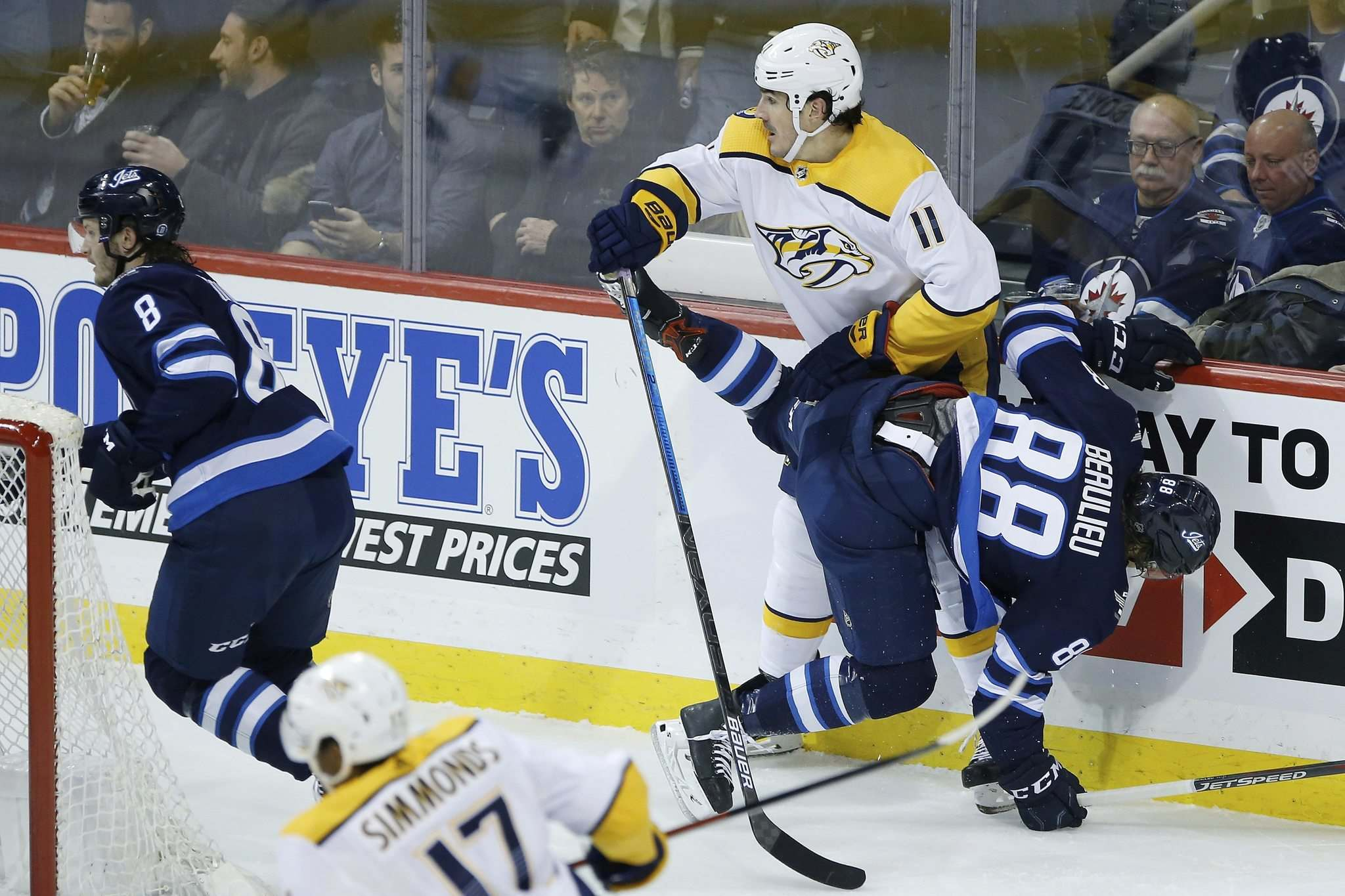 John Woods / The Canadian Press</p><p>Predators newcomer Brian Boyle blasts Jets newbie Nathan Beaulieu during Winnipeg's 5-3 win Friday night.</p></p>