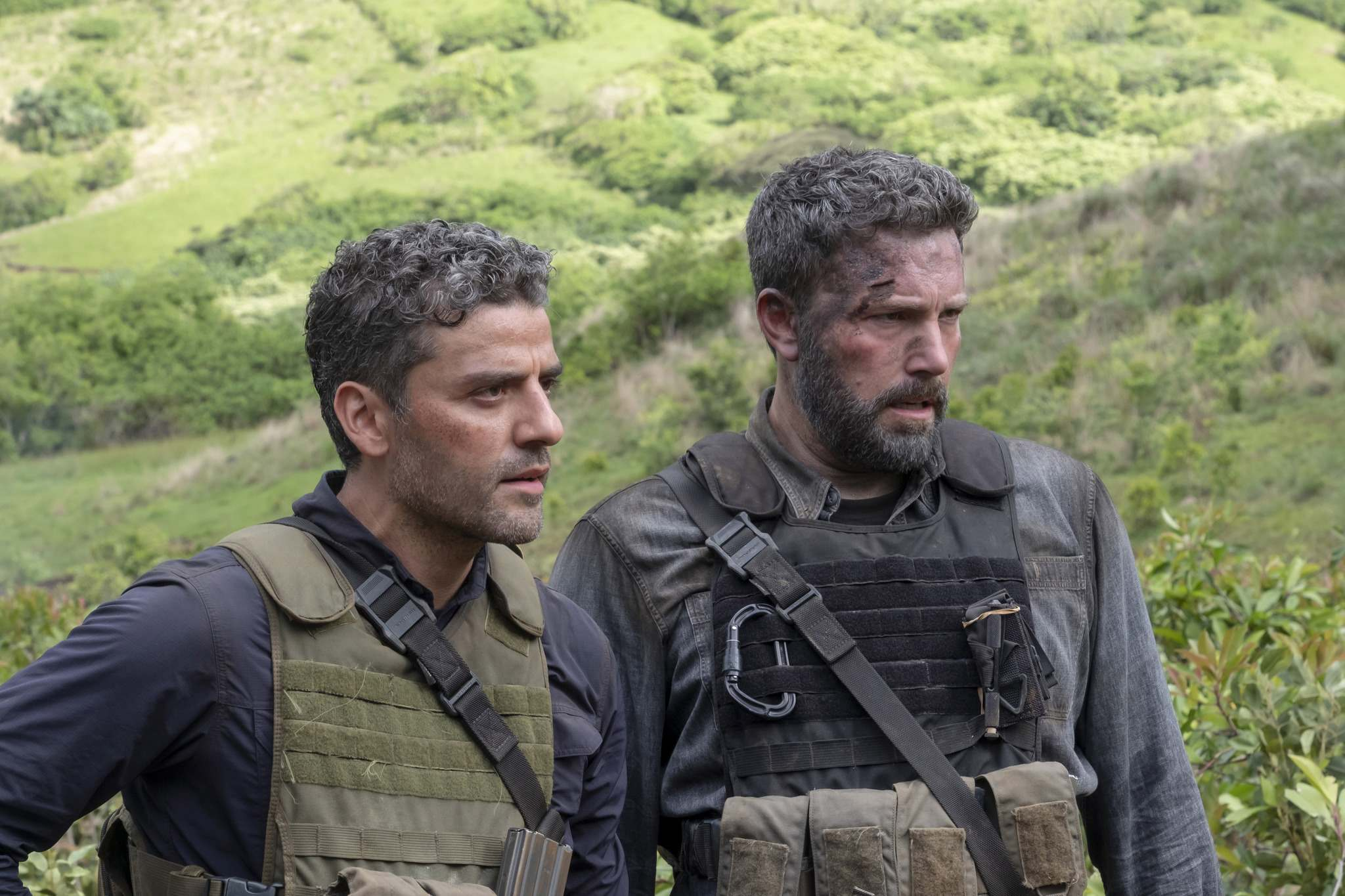 Oscar Isaac, left and Ben Affleck (Netflix)</p>