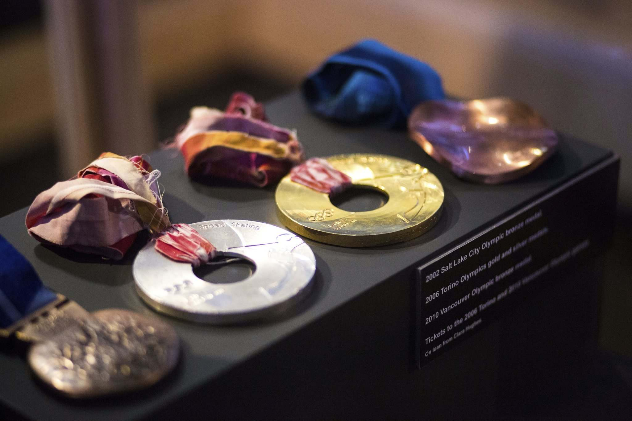<p>Olympic medals on display at the Manitoba Sports Hall of Fame.</p>