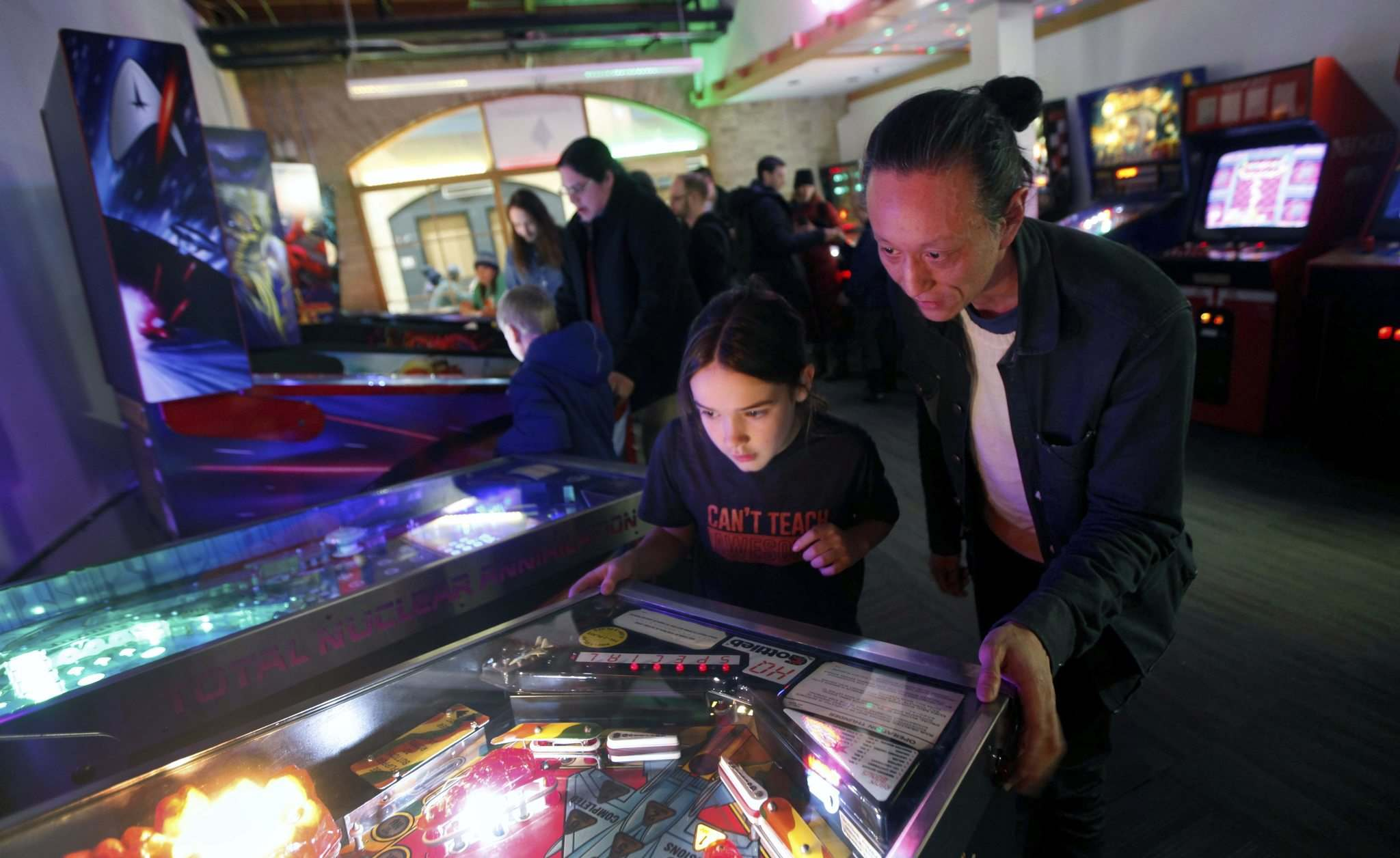 Cliff Lee (right) and Nolan Swanson-Bilyk enjoy a game of pinball at Flipping Out at The Forks.</p>